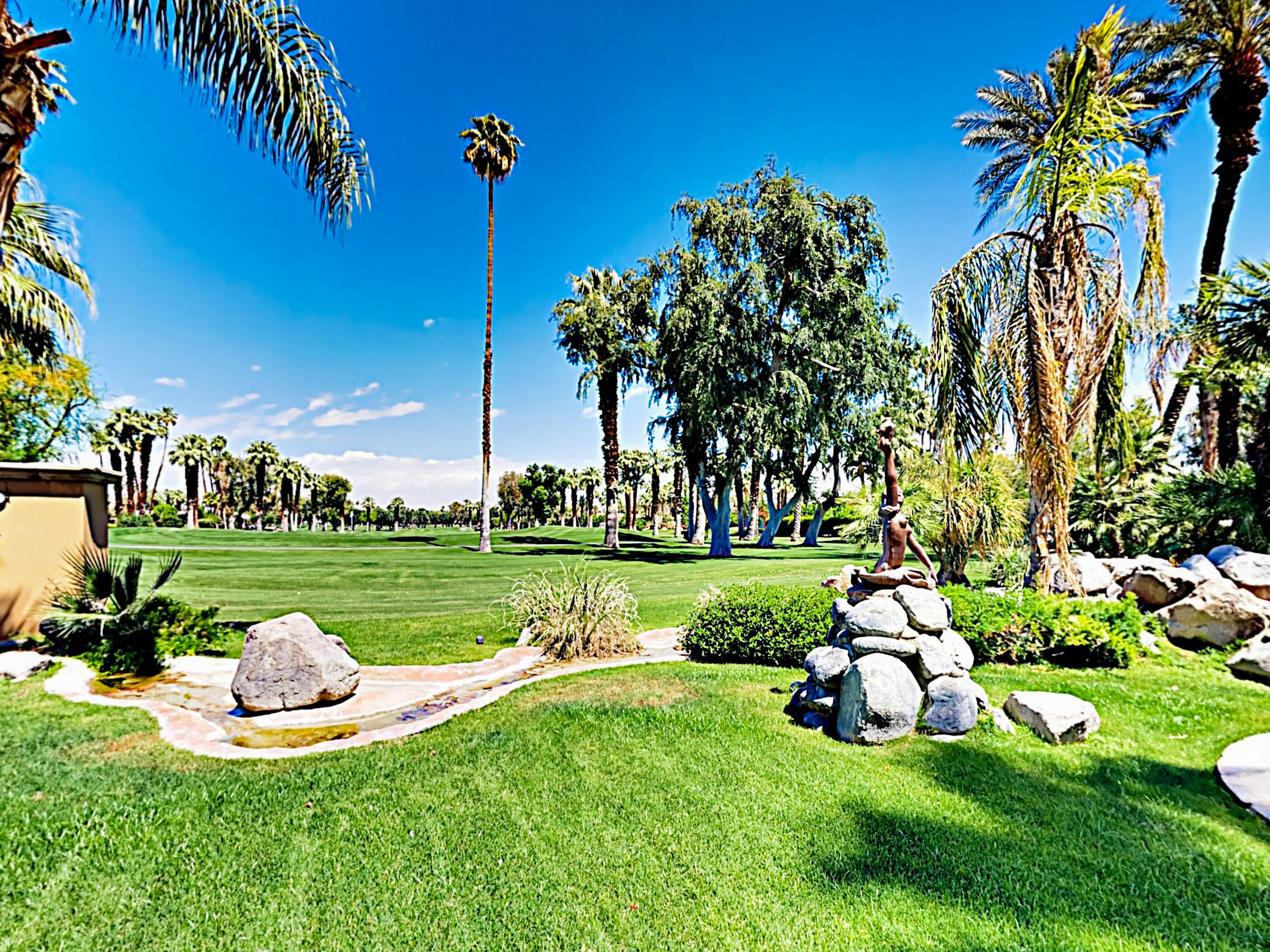 The resort-style backyard overlooks the Tamarisk Country Club Golf Course.