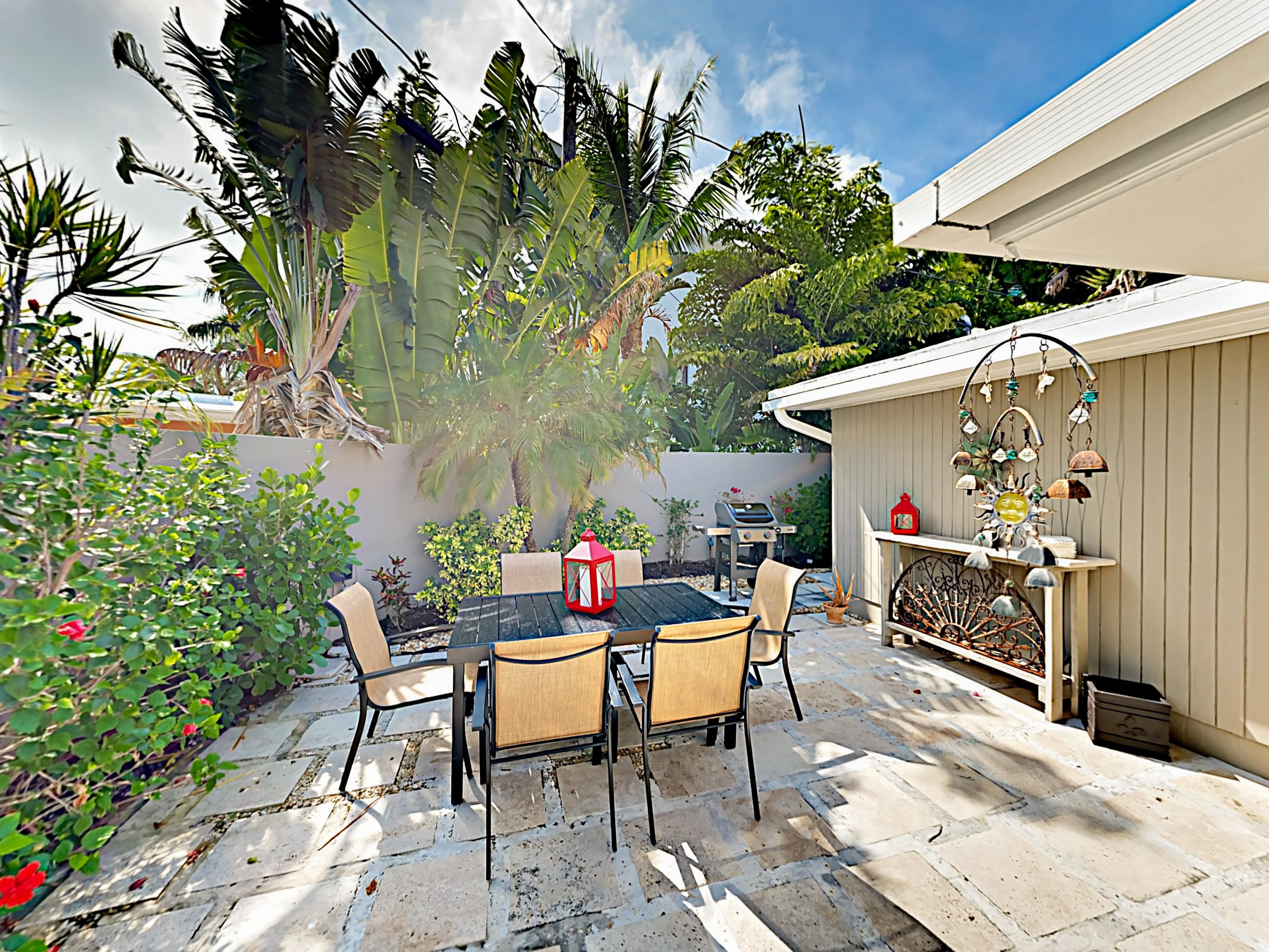 The backyard oasis offers outdoor seating for 6.