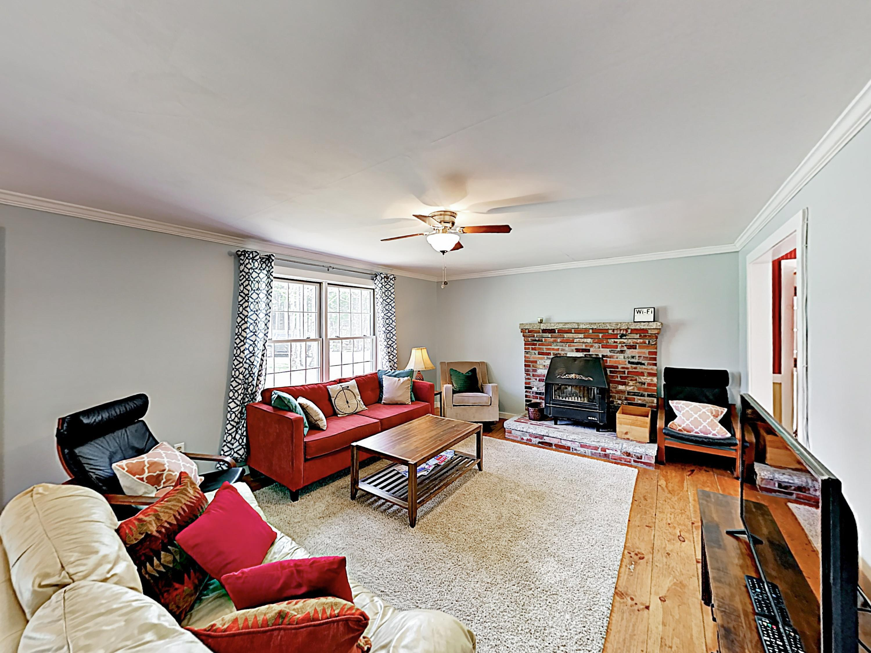 Cozy up in the living area furnished with a couch, chairs, and a flat-screen TV.