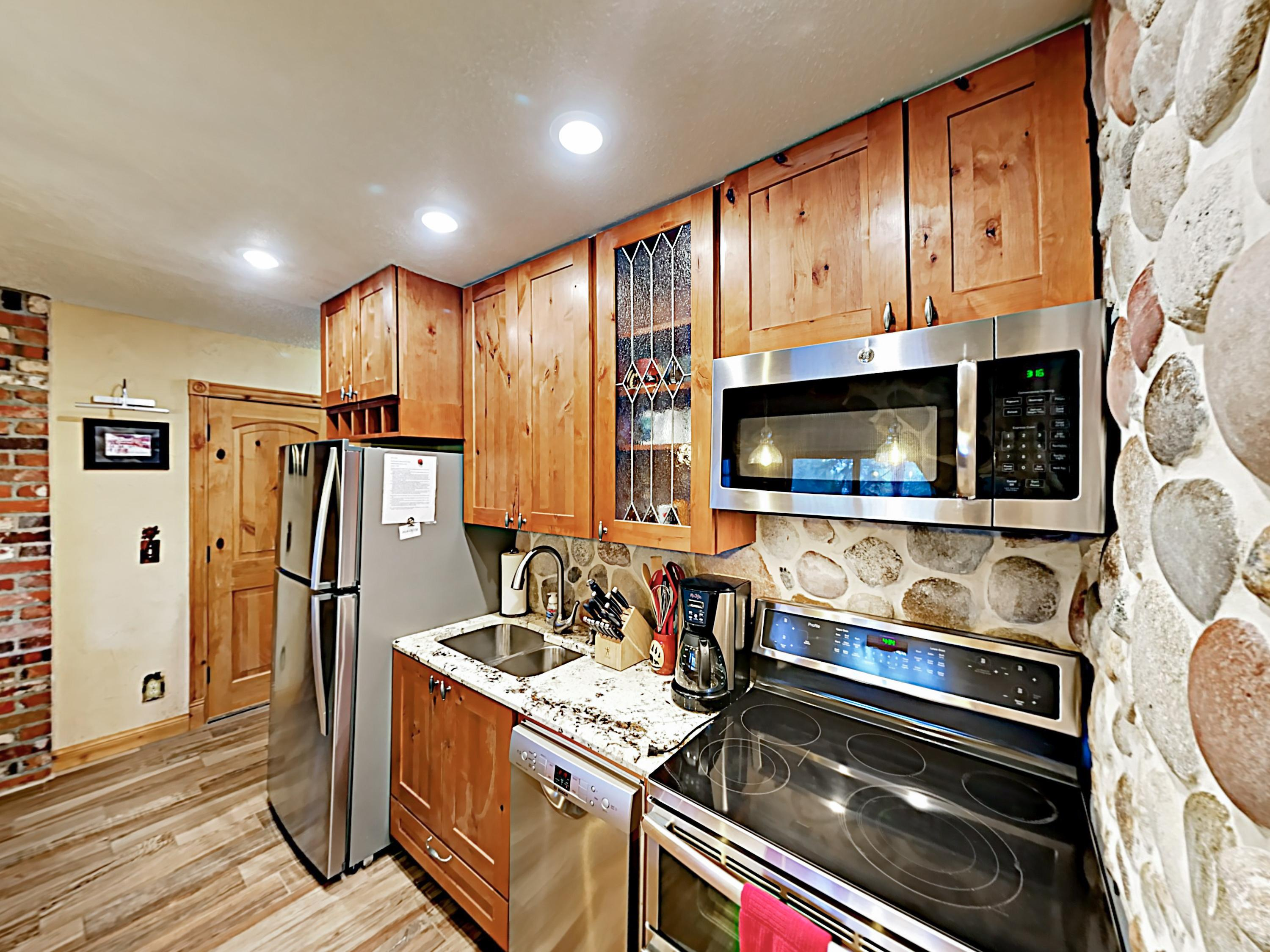 Stainless steel appliances and wood cabinets highlight the kitchen.
