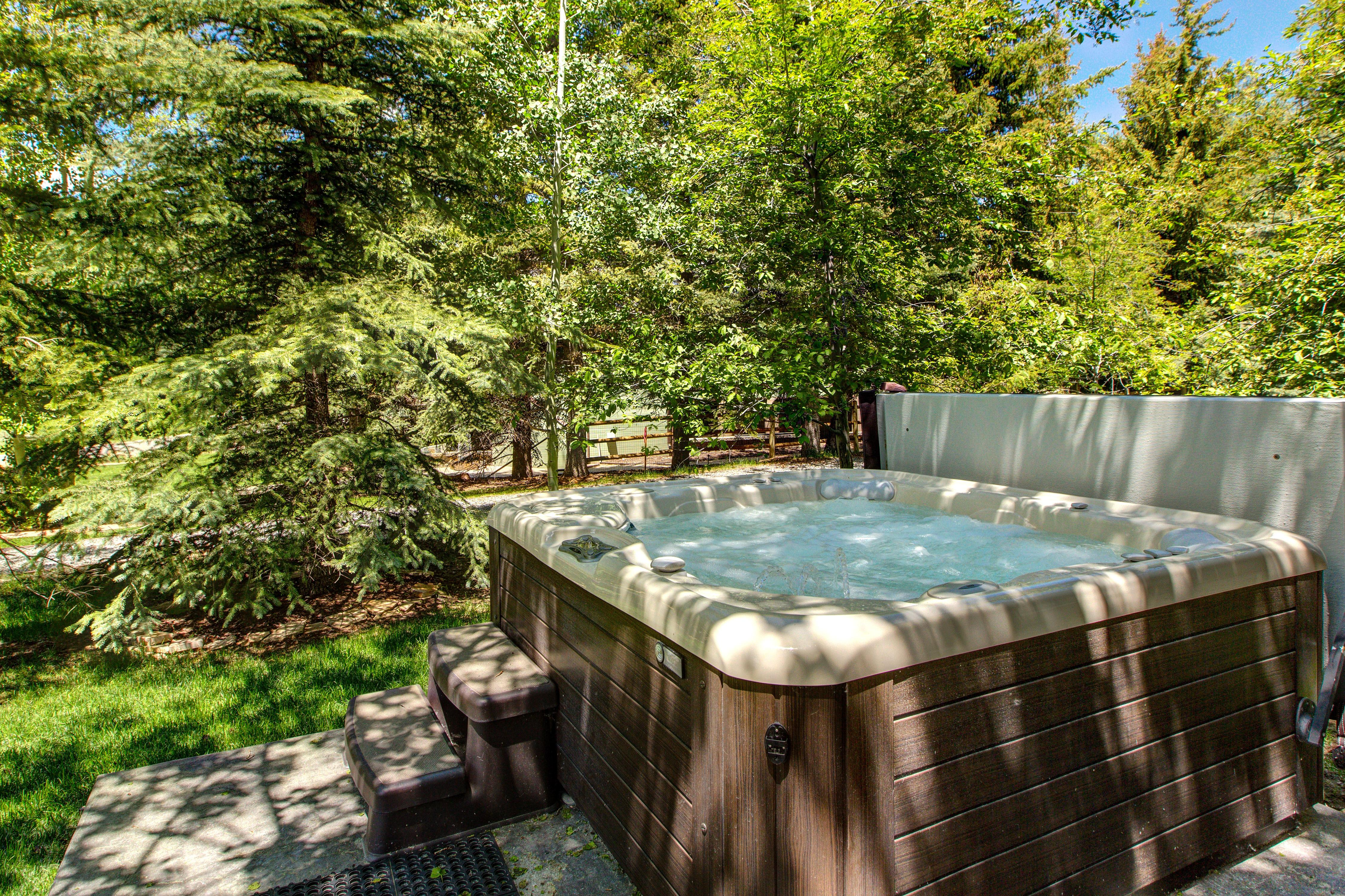 Fire up the bubbles in your private hot tub!