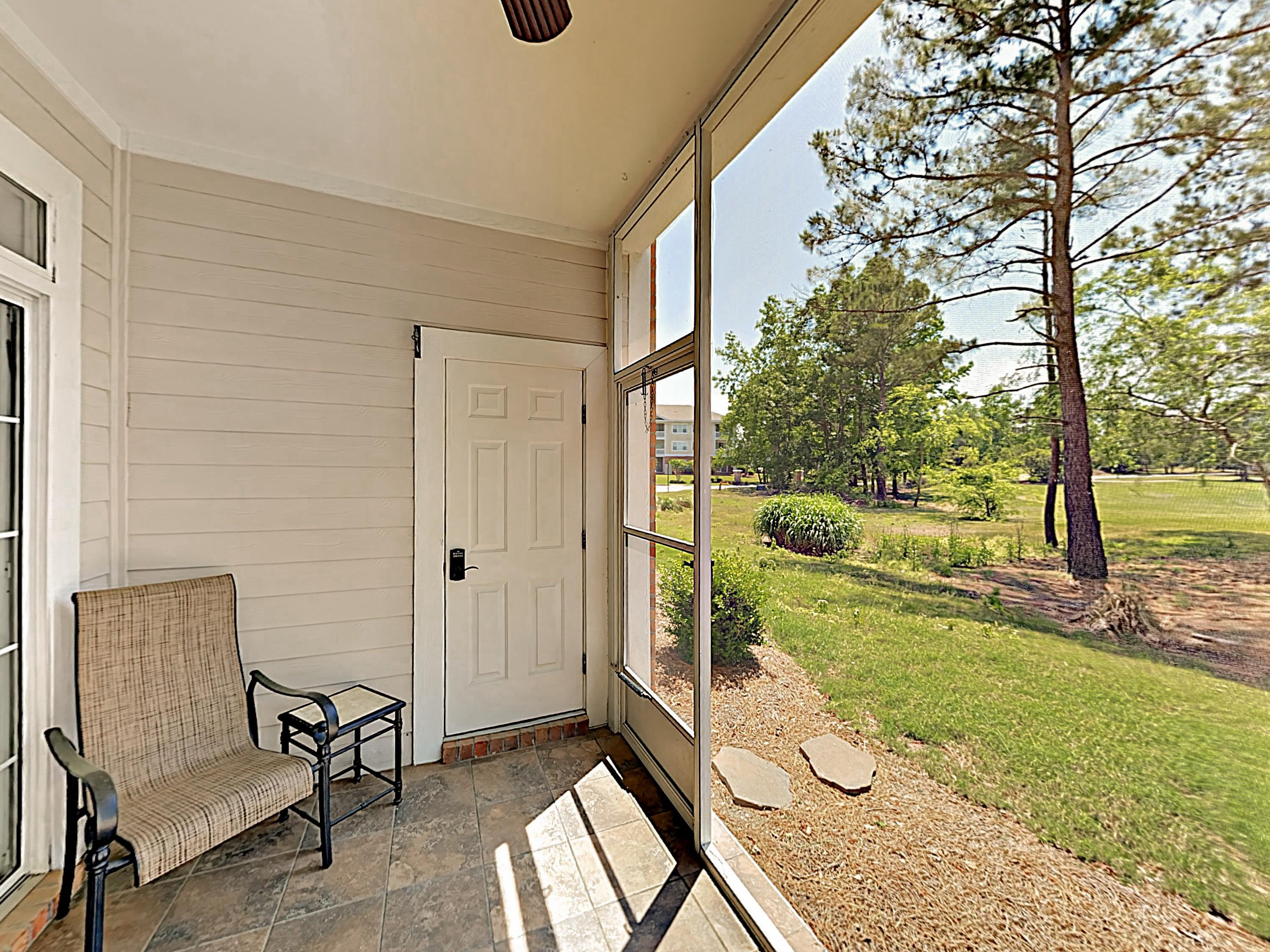 Enjoy views of the complex green space from the screened patio.