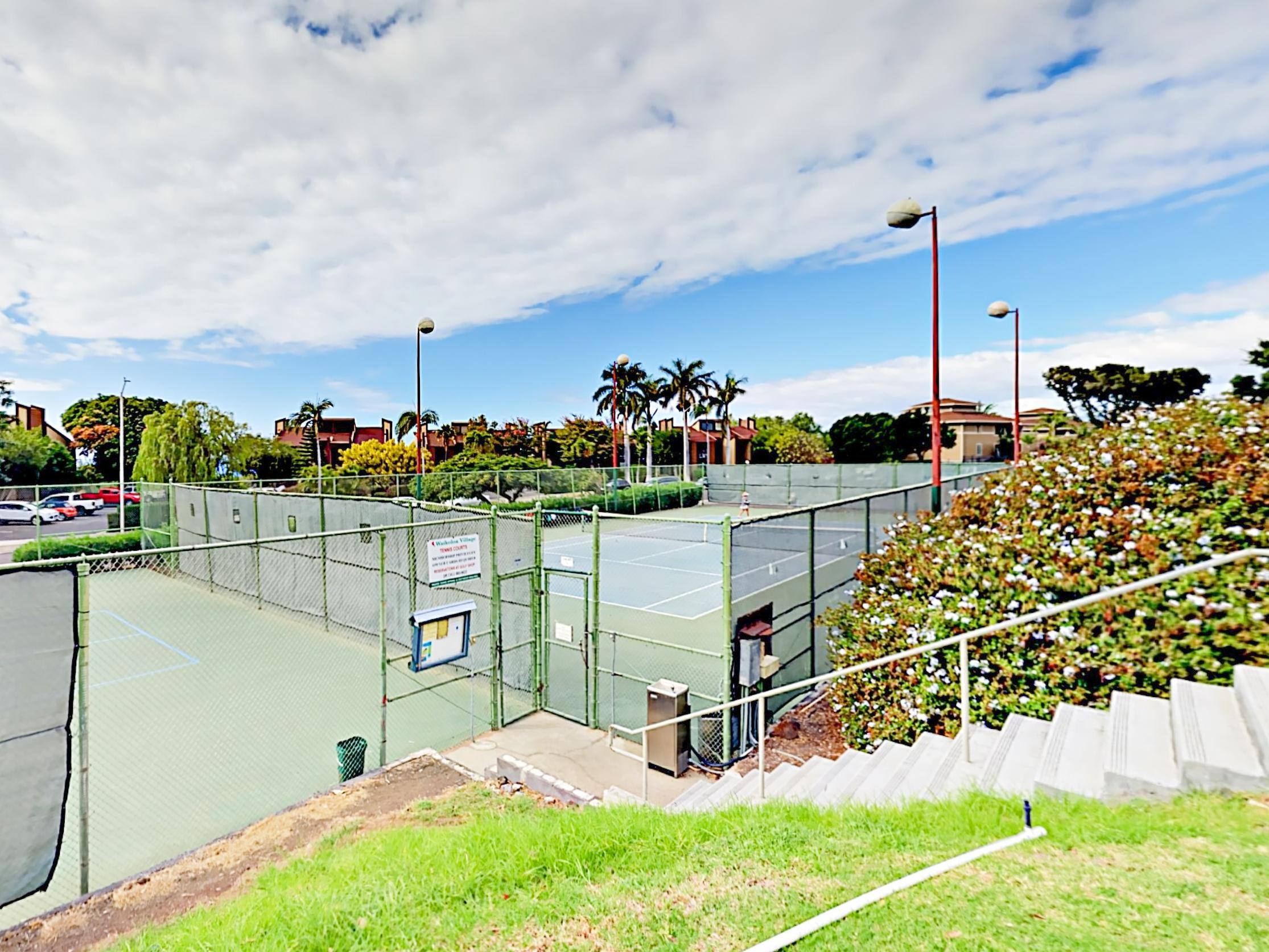 Practice your serve on the community tennis courts, just steps from your rental.