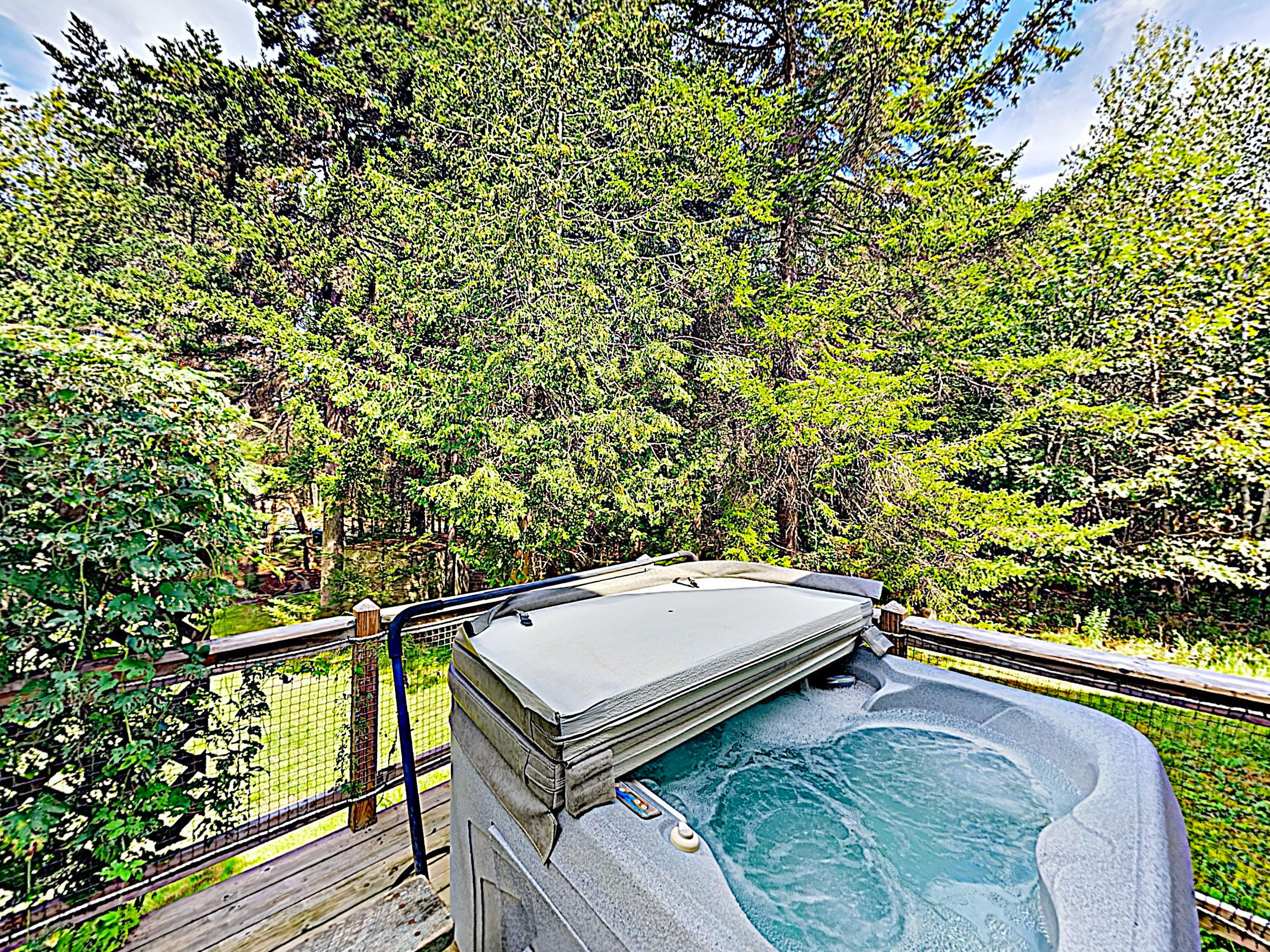 Take a rejuvenating soak in the private hot tub.