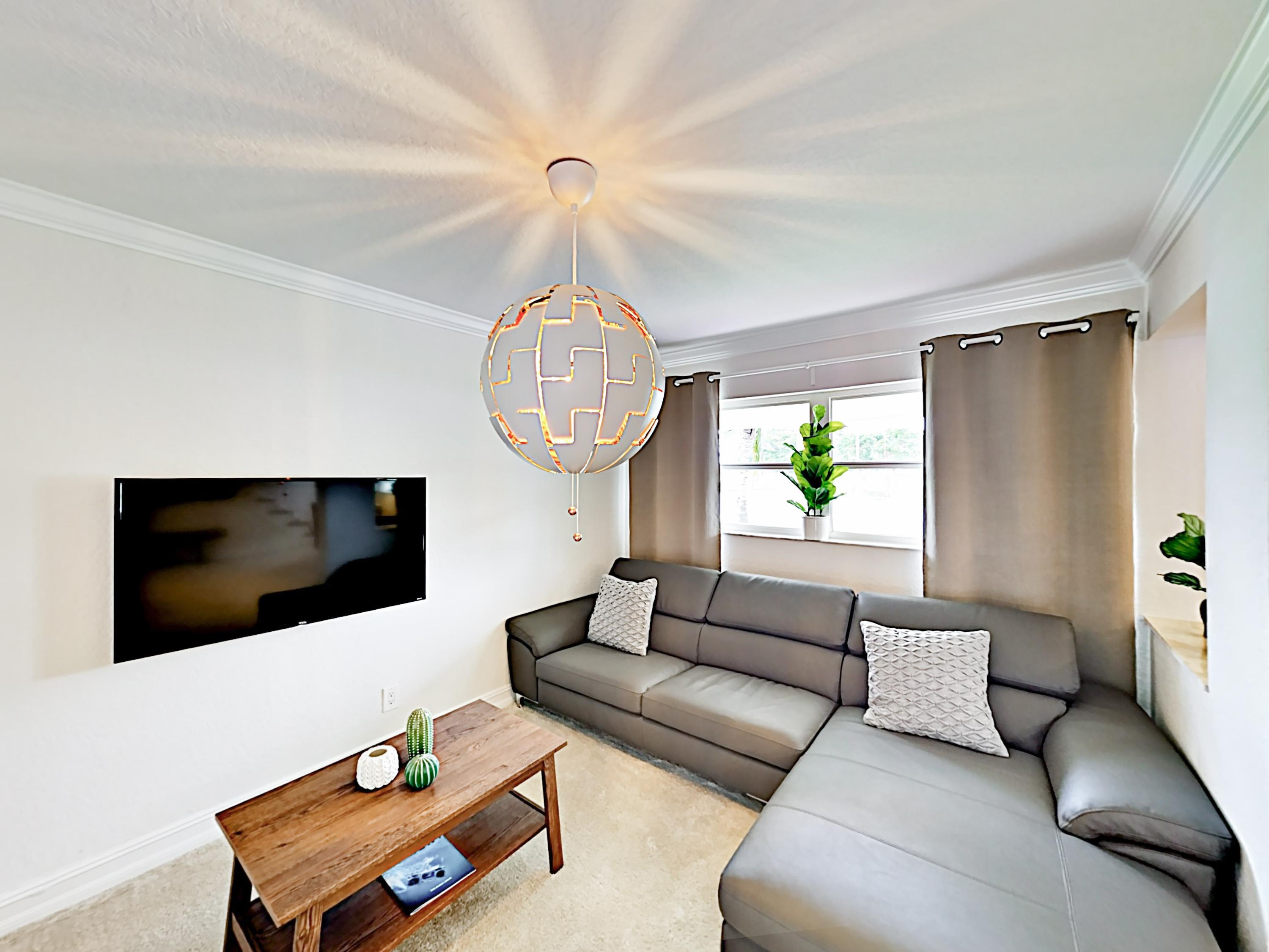 The well-appointed living area includes a sectional and flat-screen TV. Complimentary Wi-Fi is provided.
