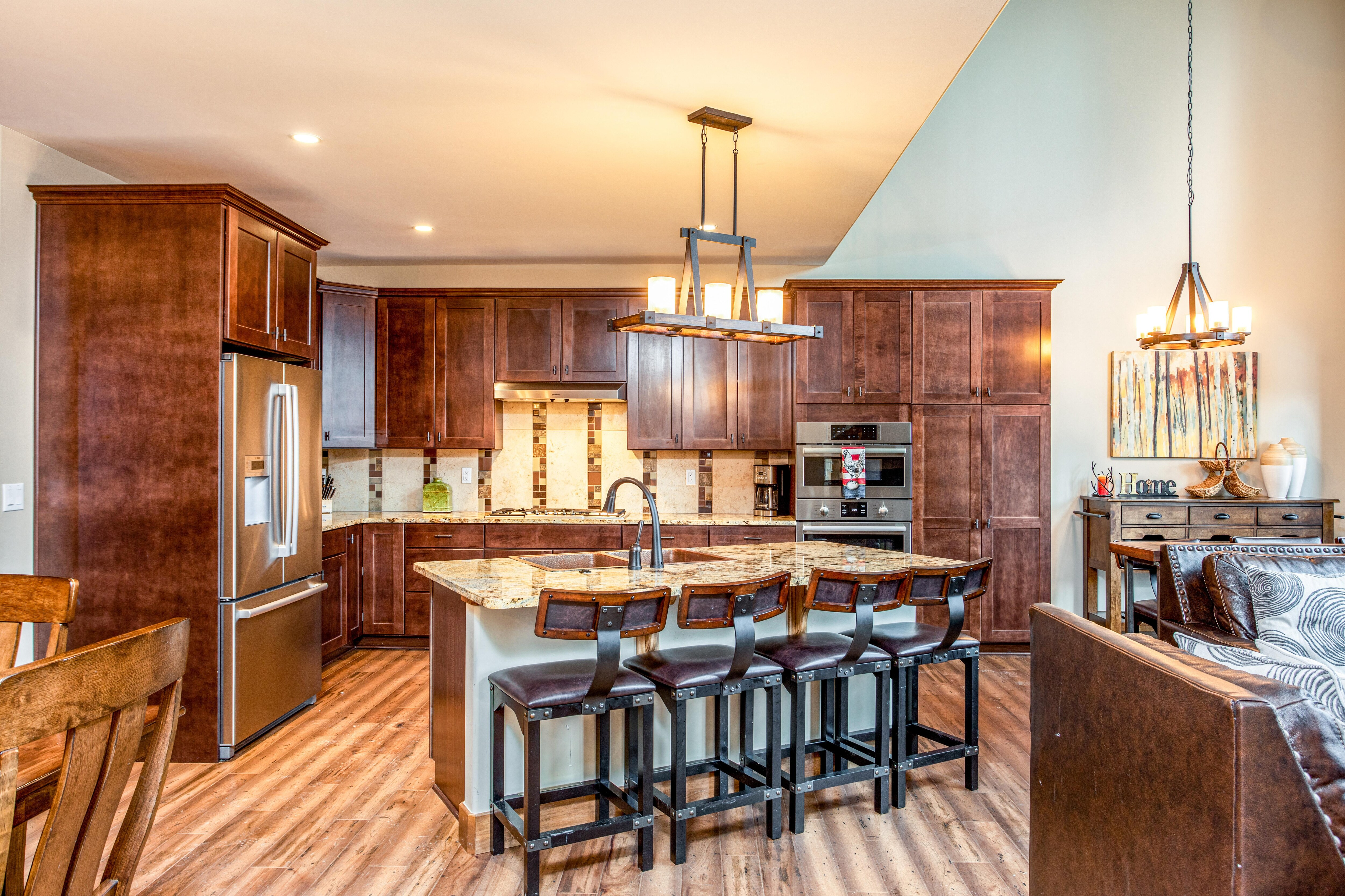 Unit 1: Granite countertops and stainless steel appliances shine in the well-equipped kitchen.