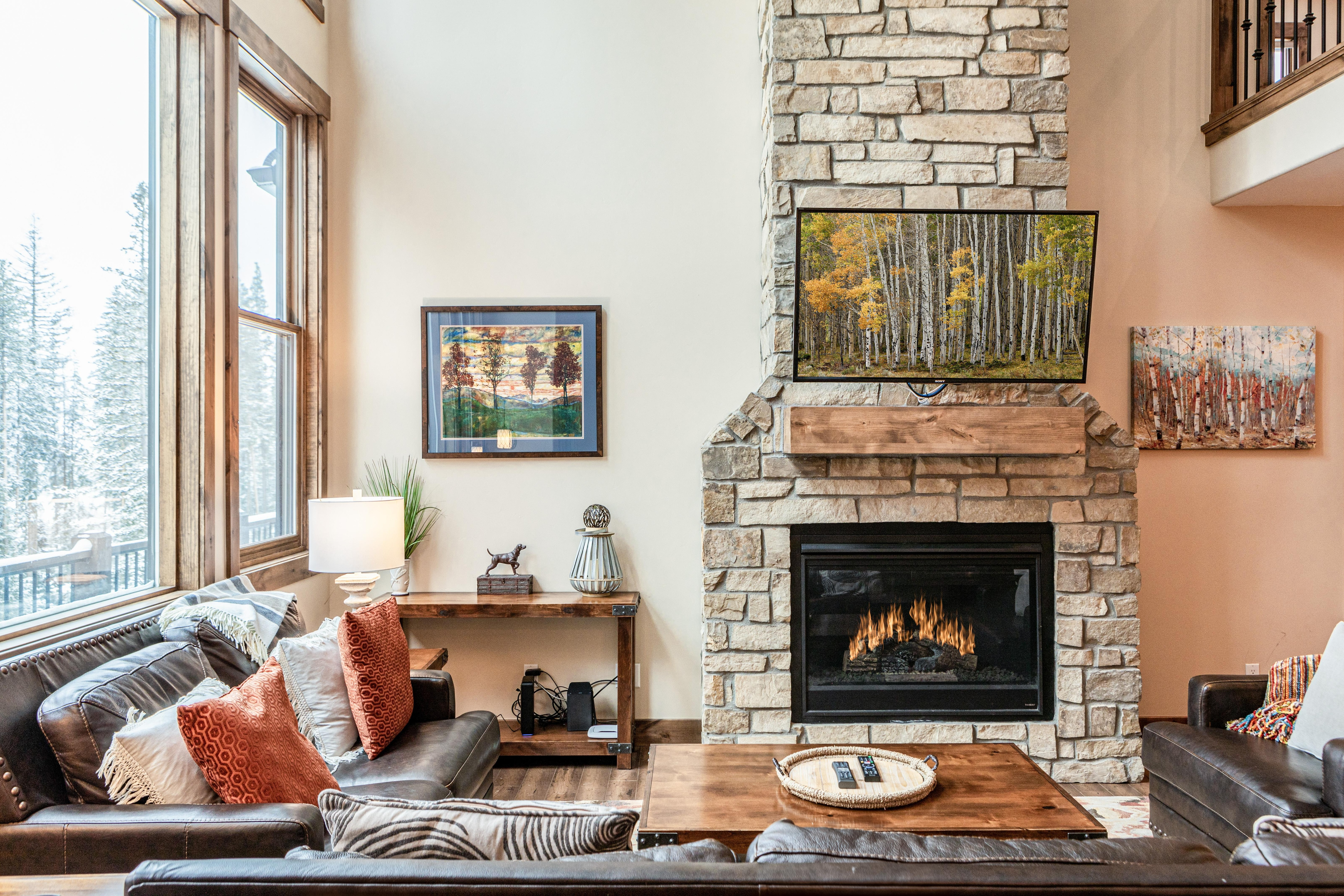 Unit 1: Cozy up next to the gas fireplace and enjoy forested views through floor-to-ceiling windows.