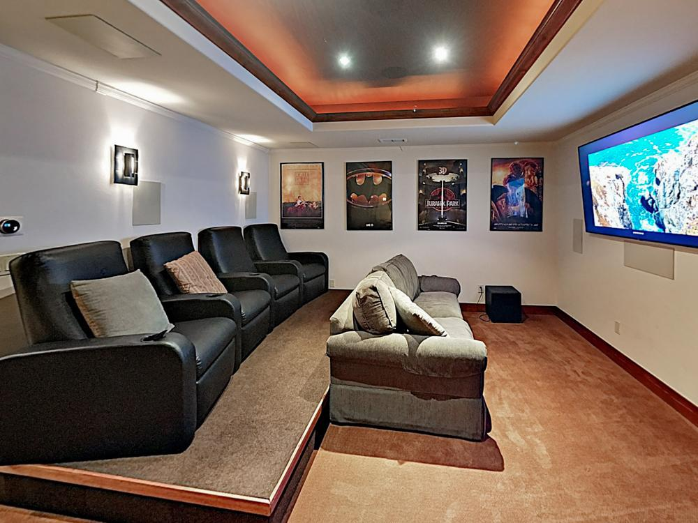 "Host a movie night in the media room, which offers a 70"" TV, as well as 4 recliners and a sleeper sofa."