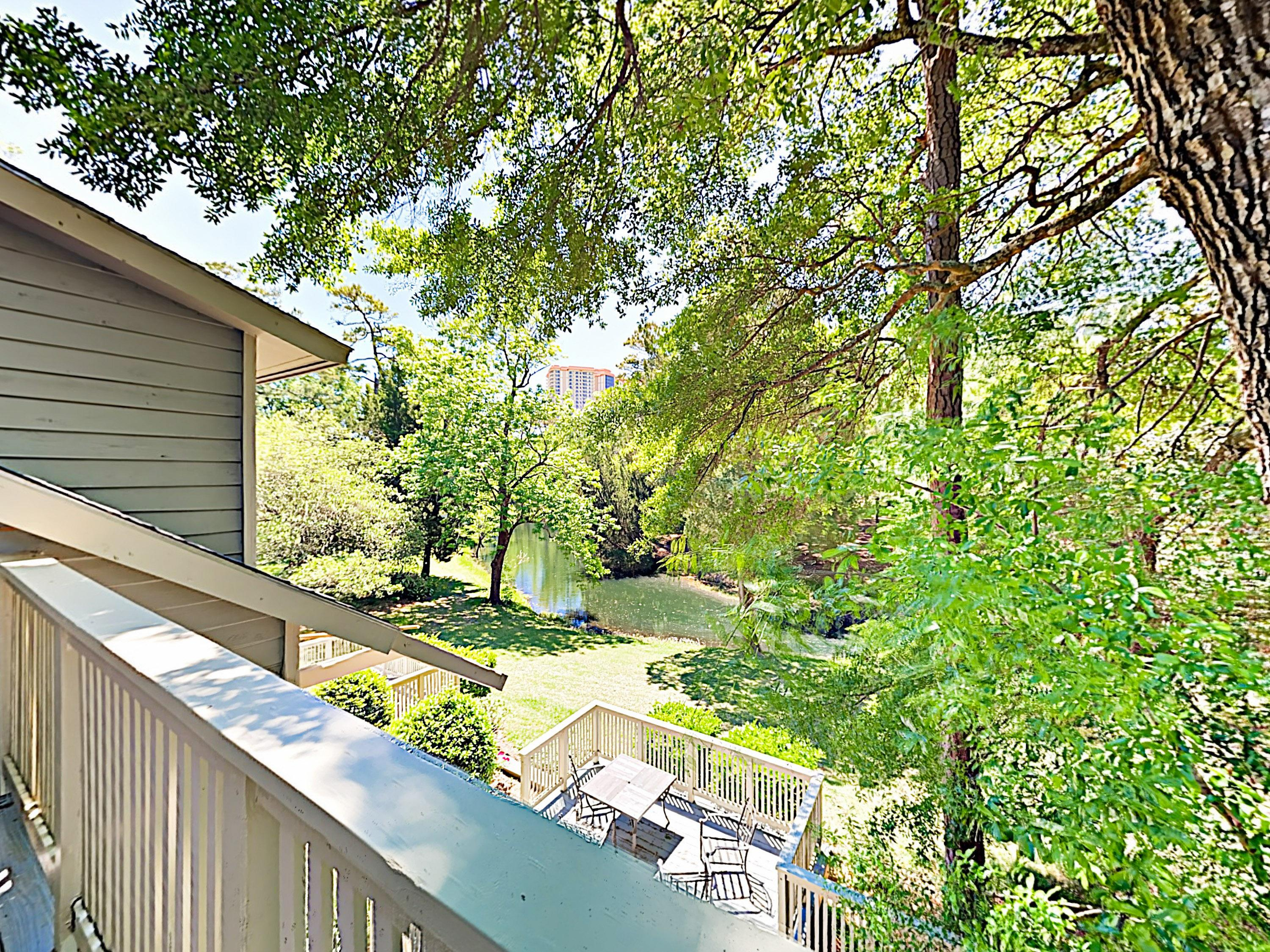 Enjoy views of the wooded landscape from the 2nd-story balcony.