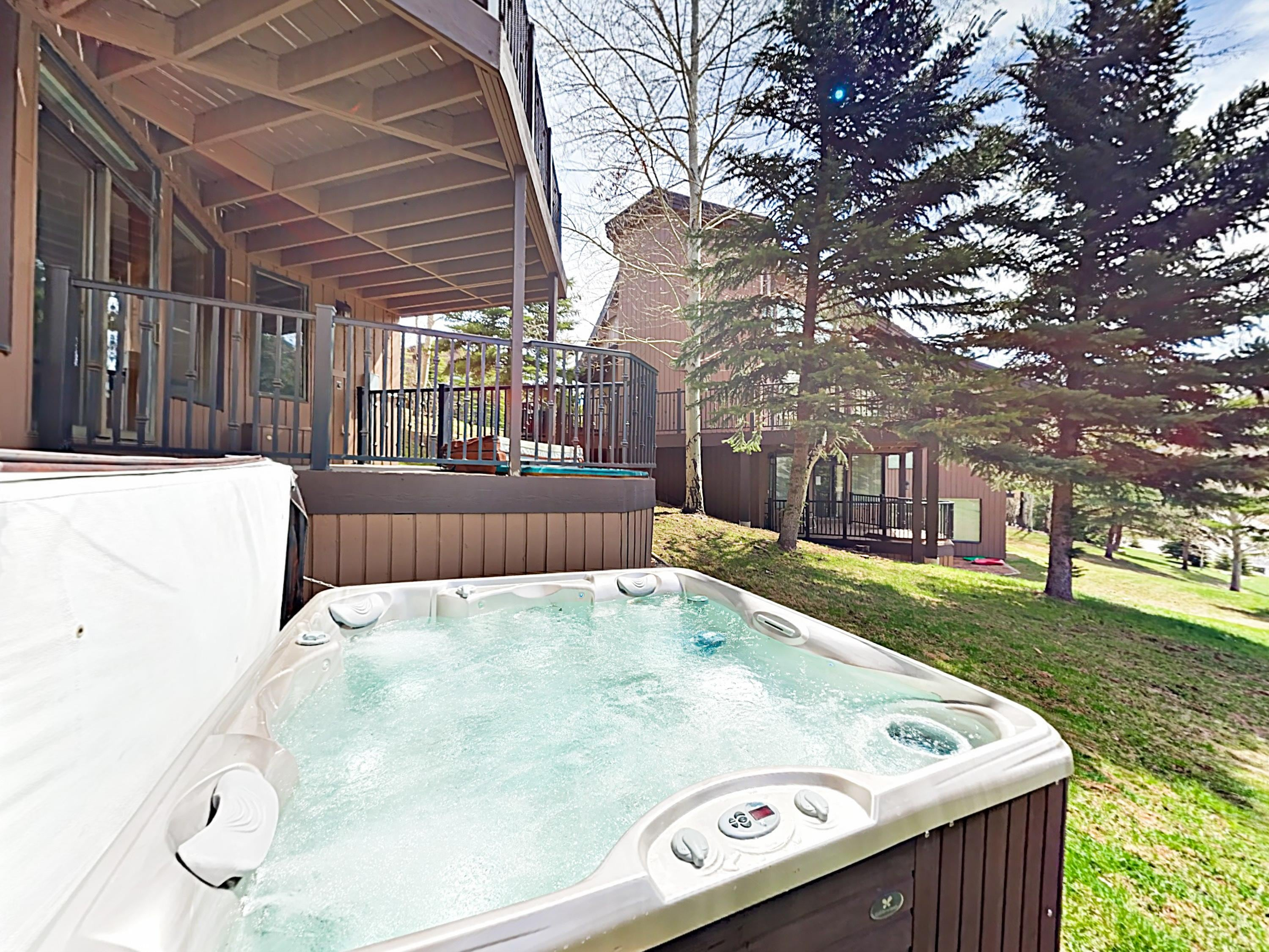 After a day of skiing, fire up the bubbles in your private hot tub!