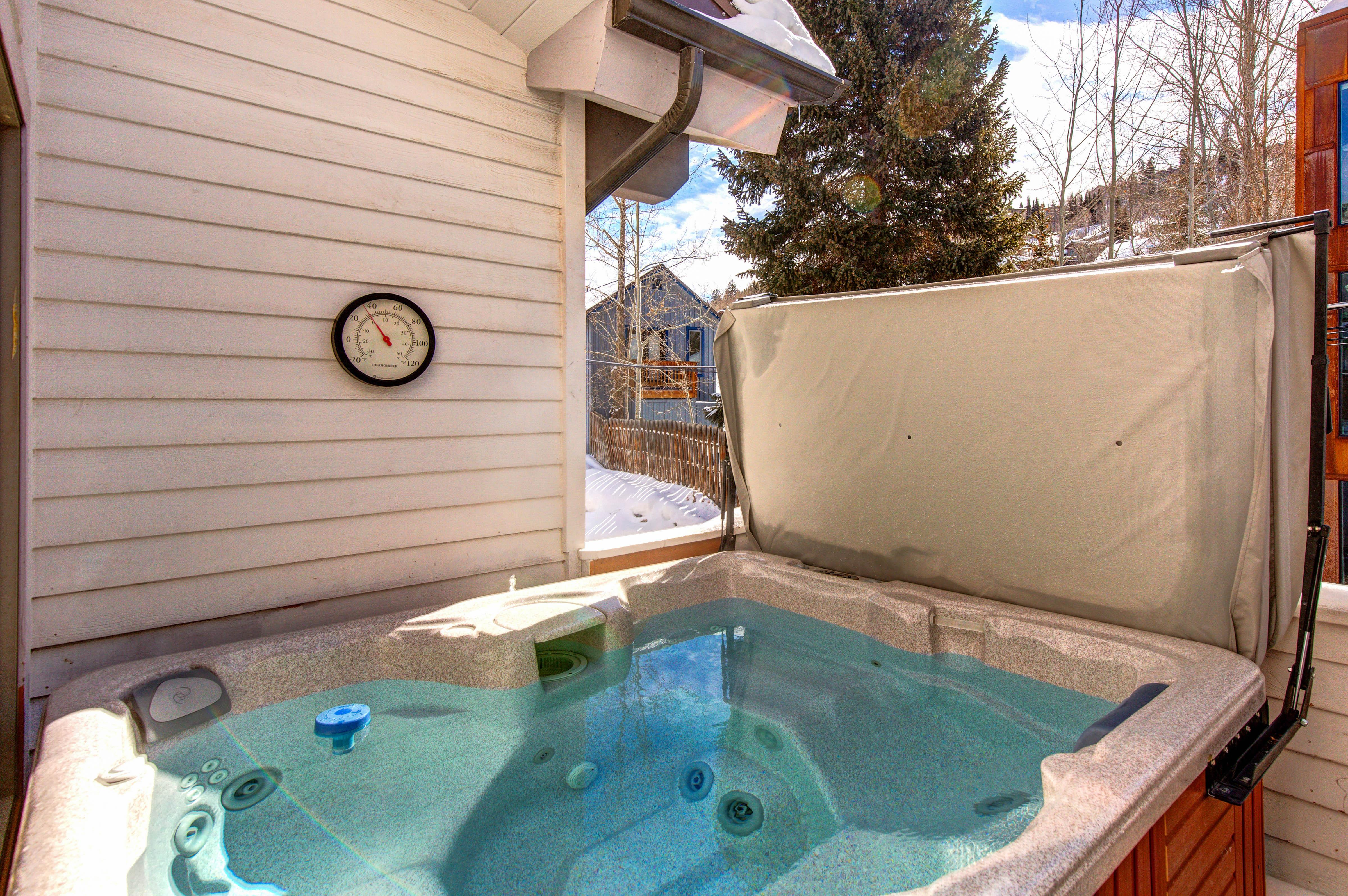 A private open-air hot tub awaits on 1 of 2 balconies.
