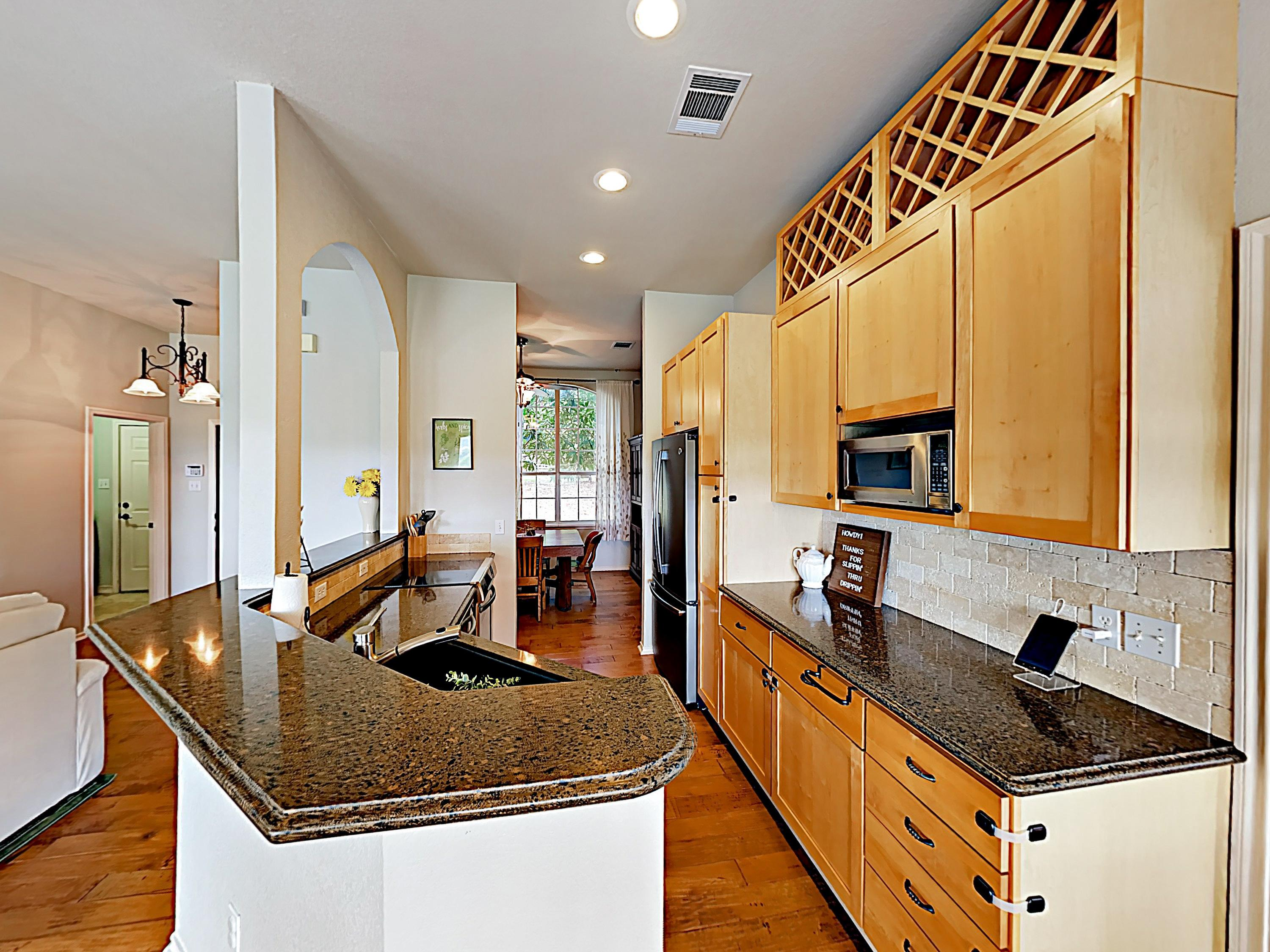 Whip up dinner in the gourmet kitchen, outfitted with sparkling marble countertops and stainless steel appliances.