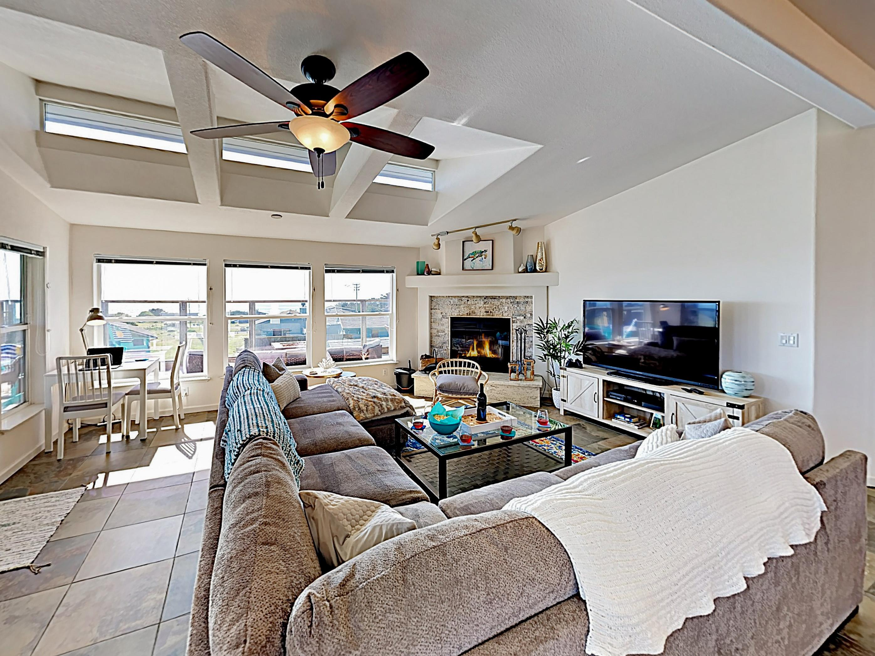 Vaulted ceilings and large windows create a stunning open living area.