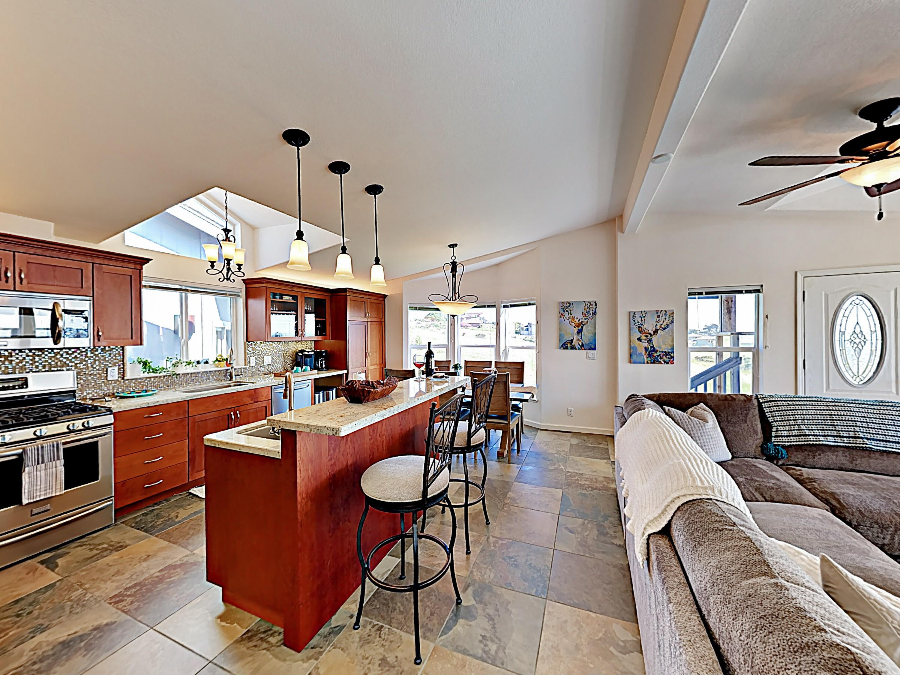 A recently remodeled kitchen offers a full suite of stainless steel appliances.