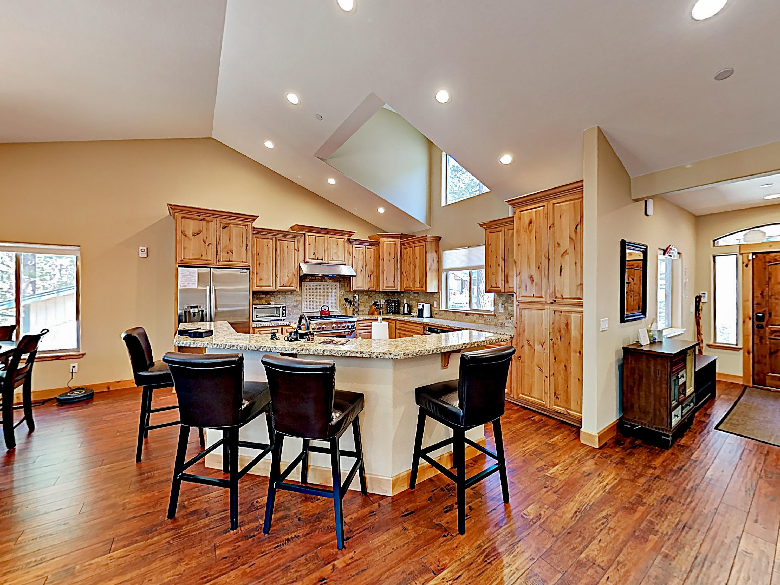 A large breakfast bar in the kitchen comfortably seats 4.