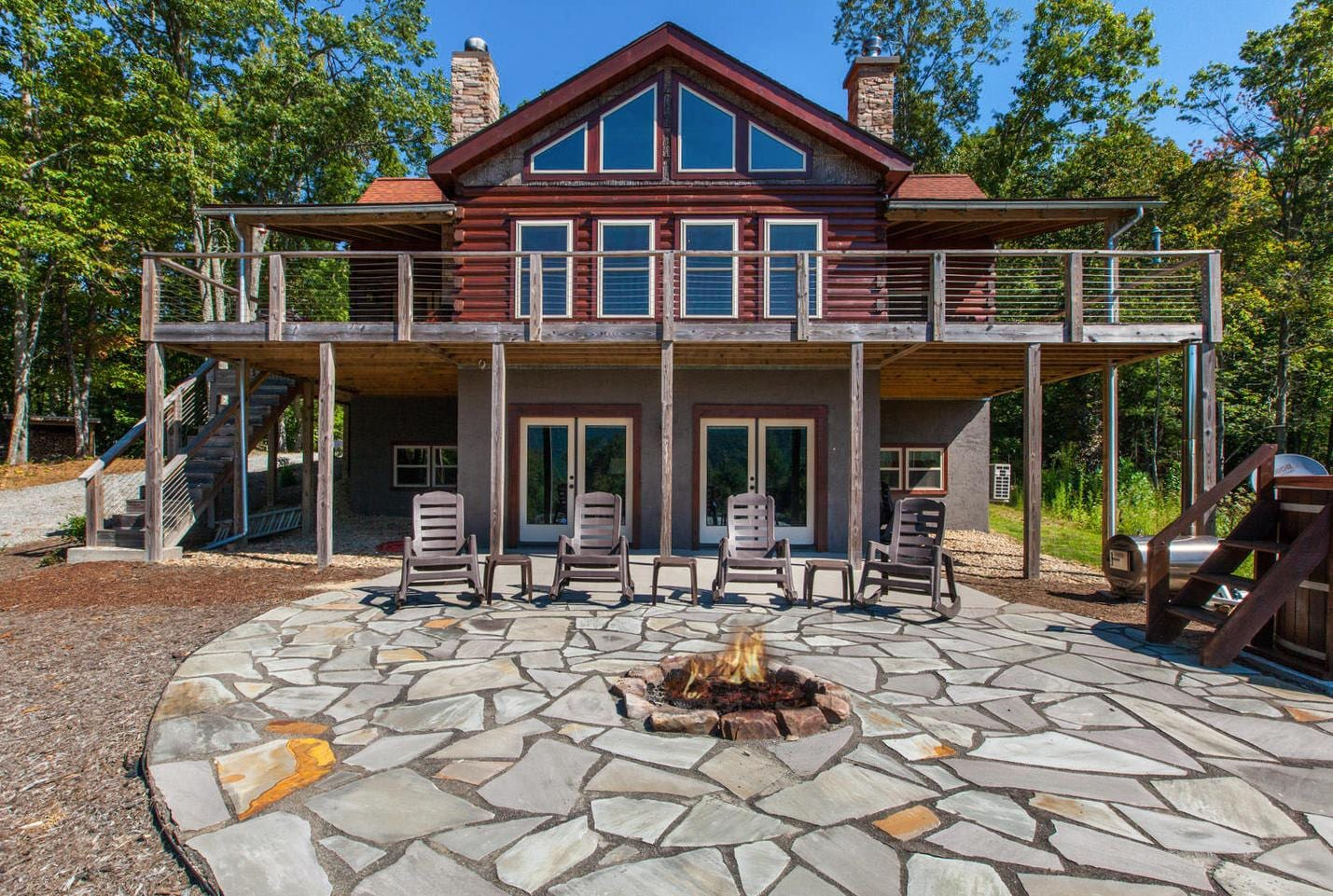 This spacious cabin retreat features an expansive deck leading to porches facing tremendous mountain views.