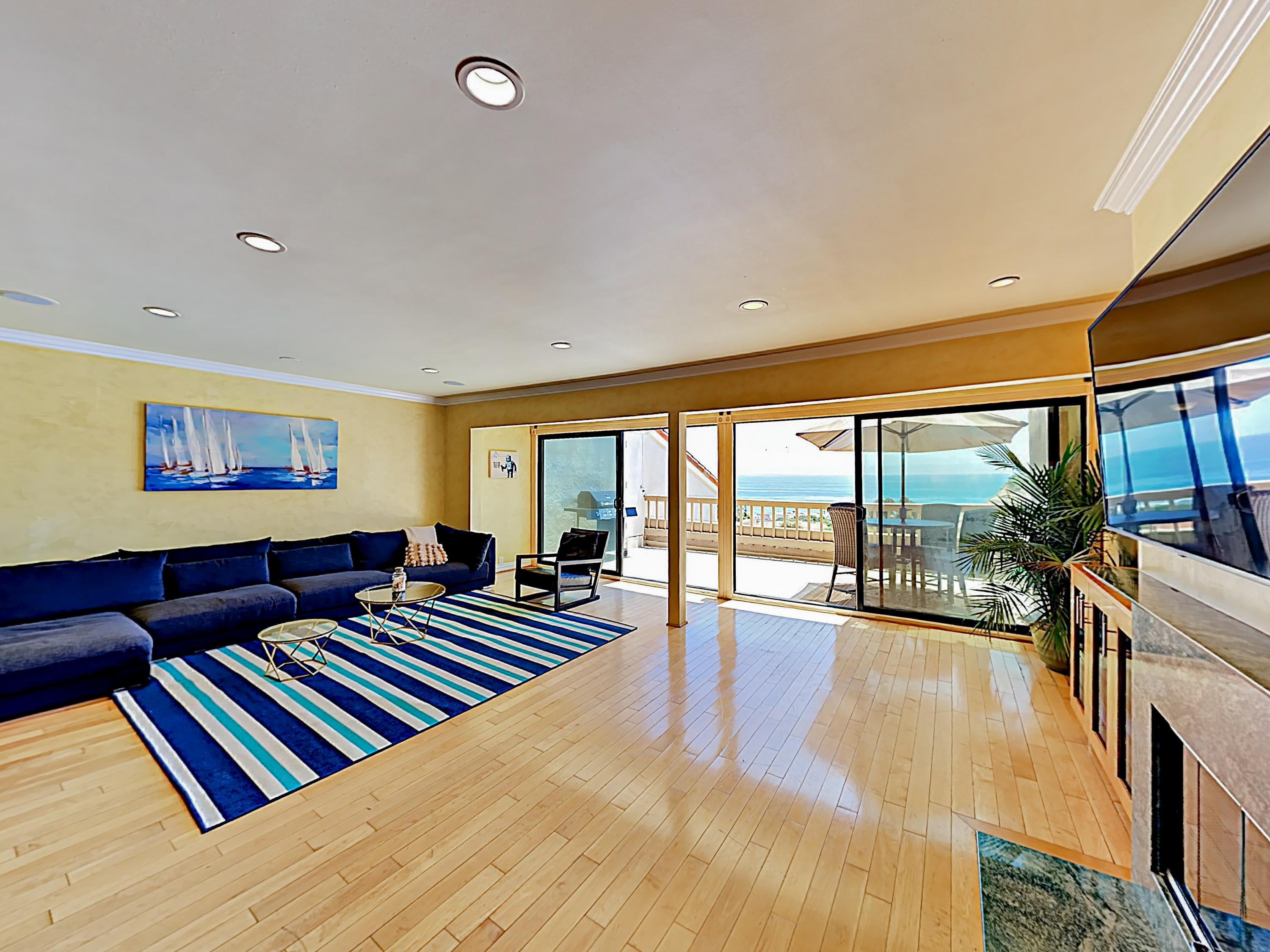 An expansive living area offers dreamy ocean views.