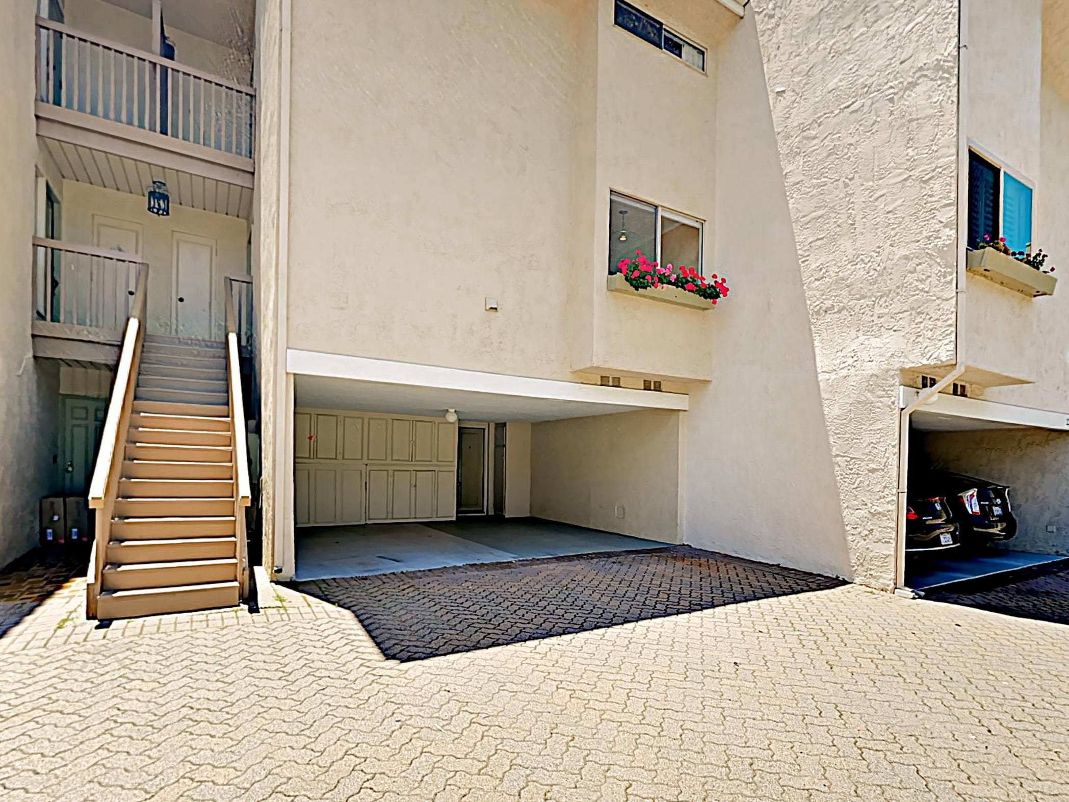 This apartment includes private parking under a carport.