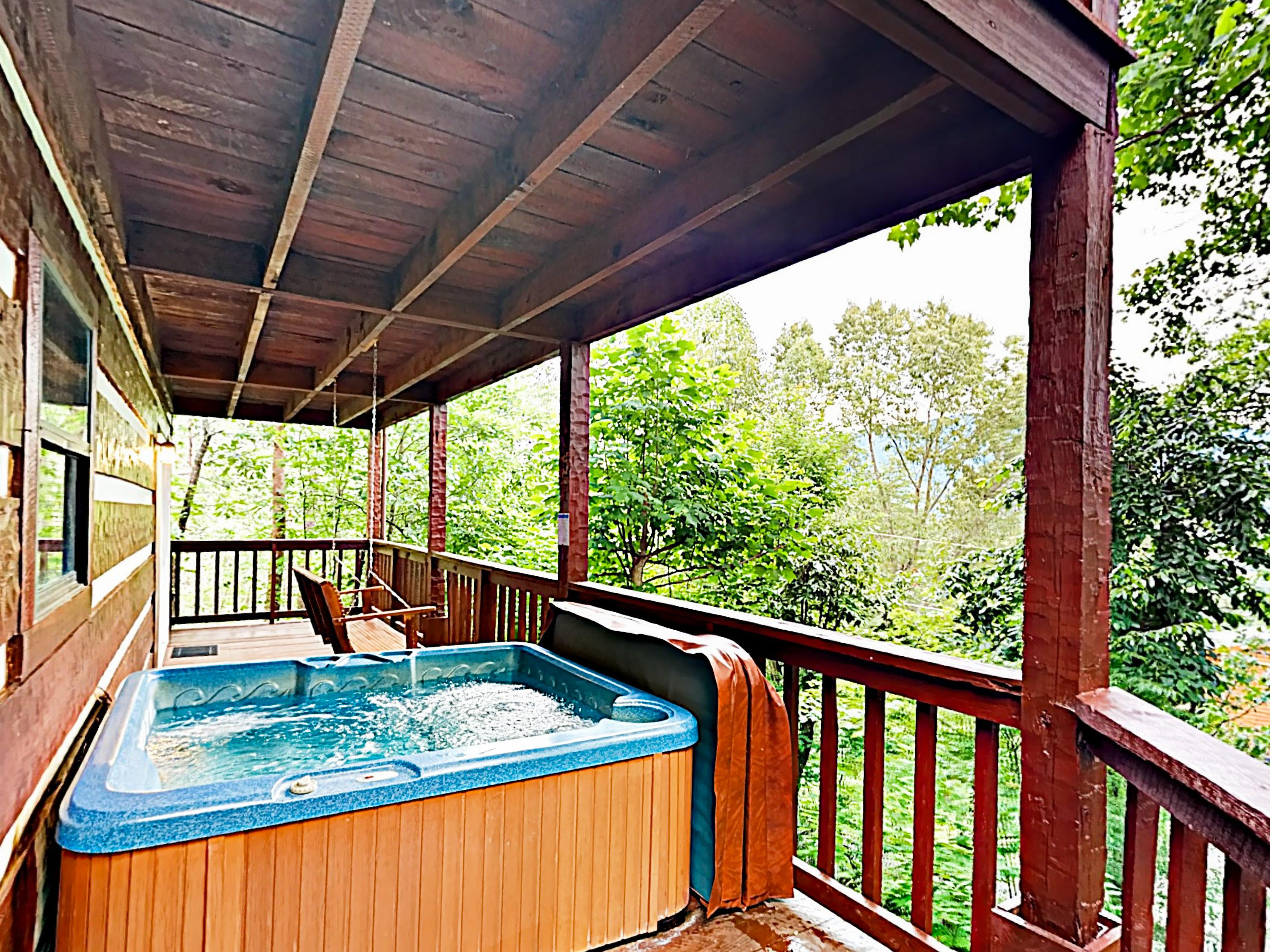 Enjoy wooded views while soaking in your private hot tub!