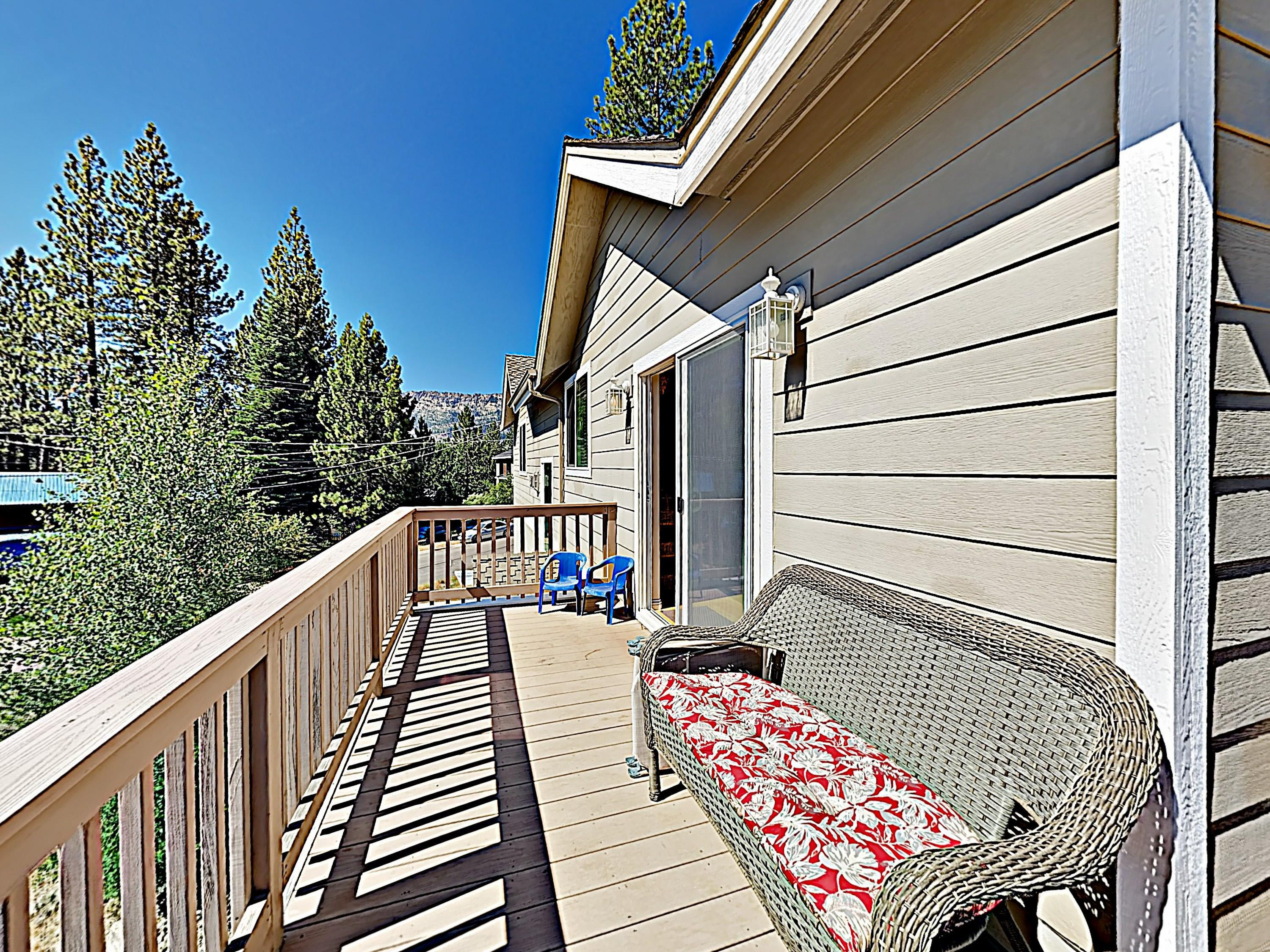 Take in mountain views from a love seat on the wraparound balcony.