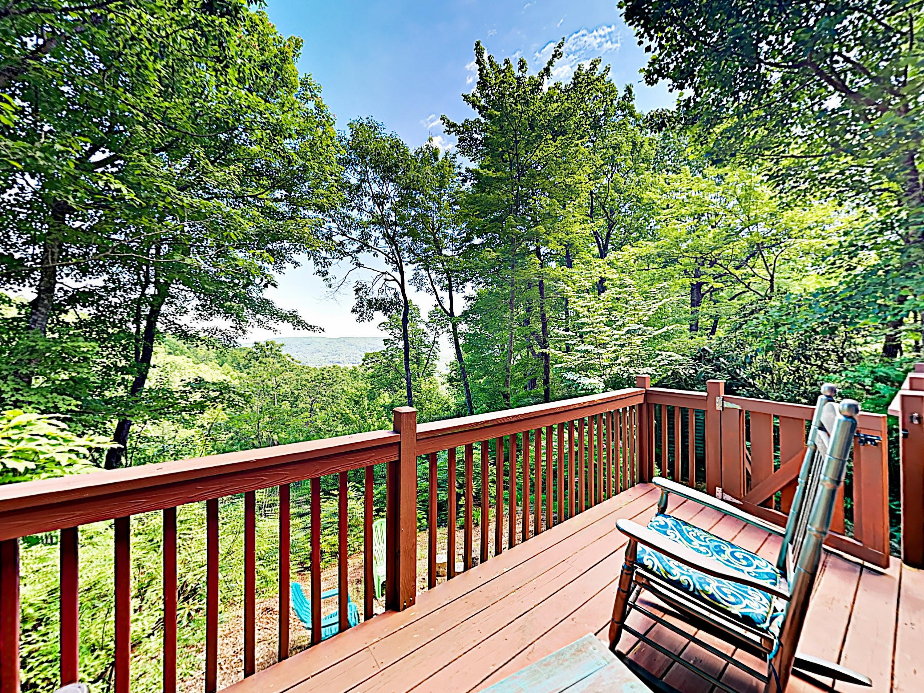 Take in sweeping views of the mountains and forest from the elevated deck.