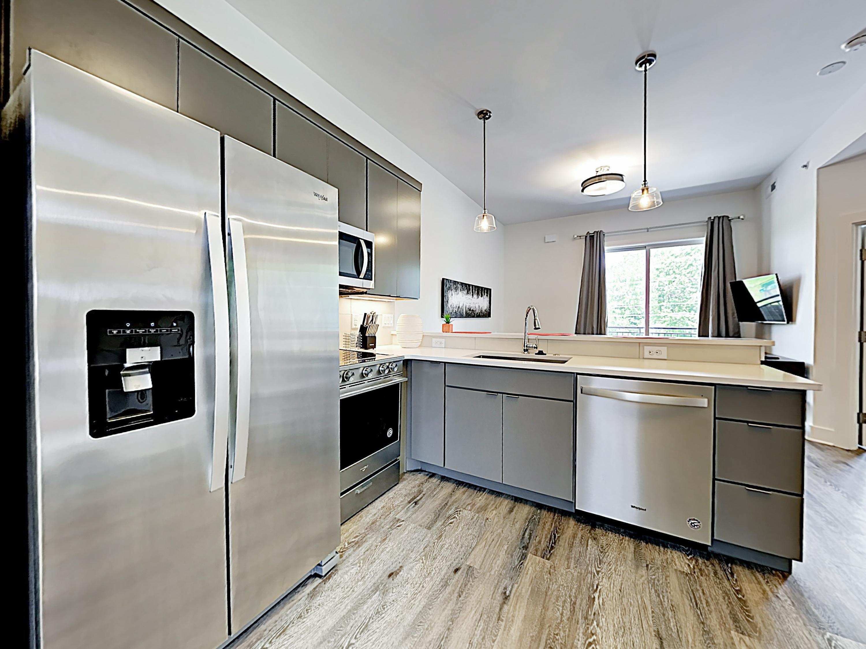 Sharpen your culinary skills in the gourmet kitchen, outfitted with stainless steel appliances and sleek granite countertops.