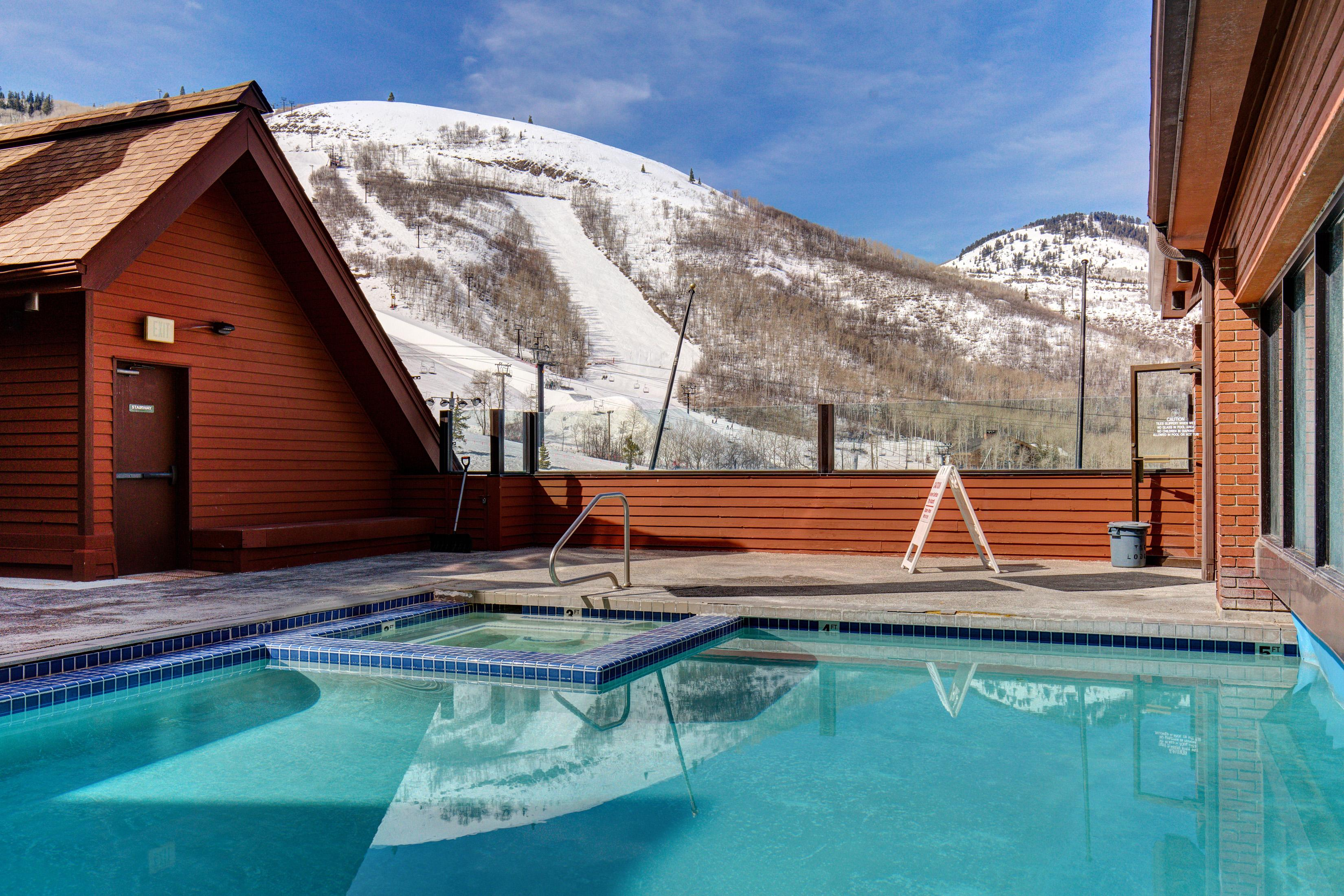 Enjoy resort amenities like a pool with a hot tub and a spectacular view of the mountains.