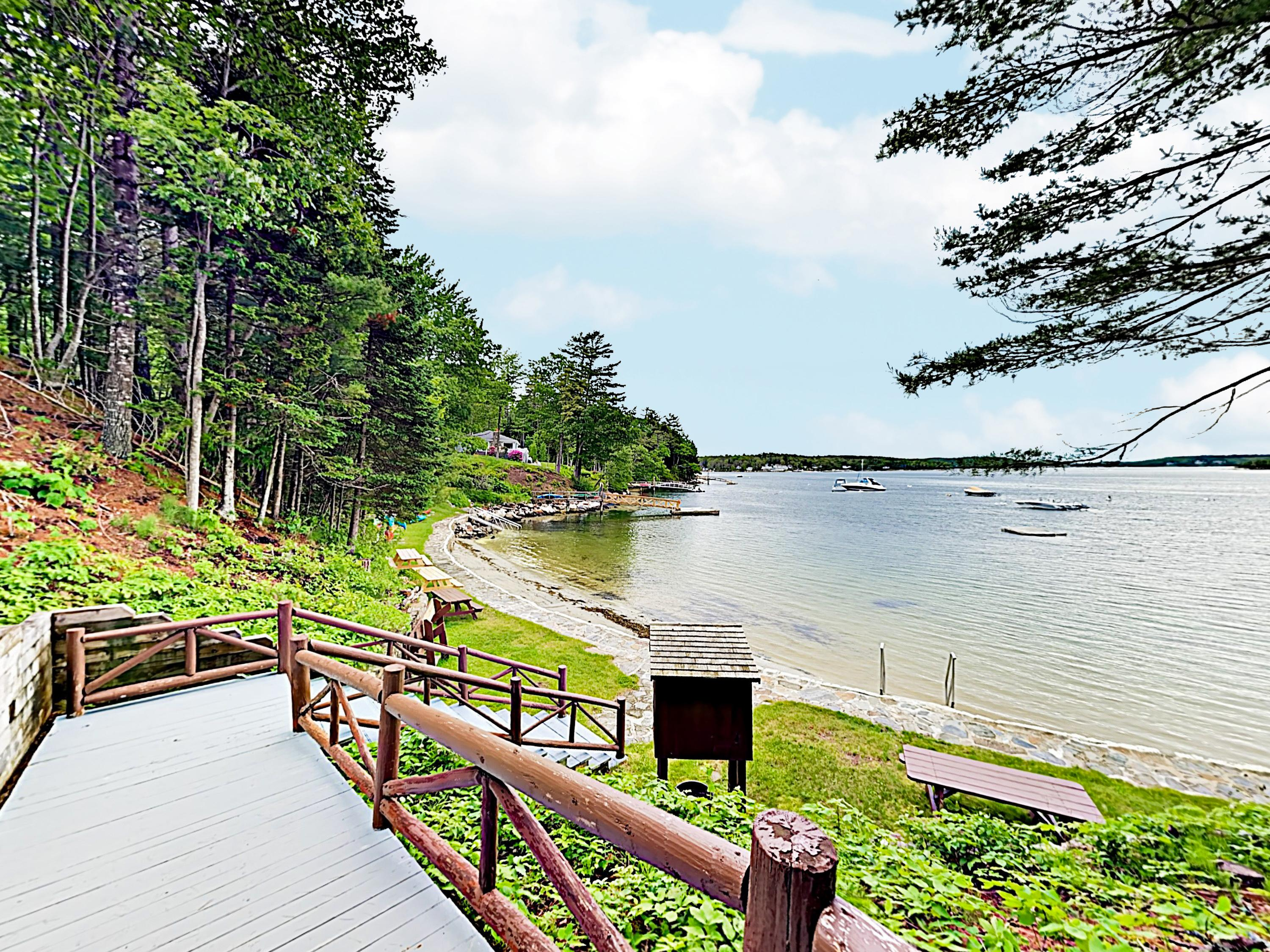 Welcome to Sprucewold! This cabin is professionally managed by TurnKey Vacation Rentals. (Beach pictured is a 15 minute walk.)