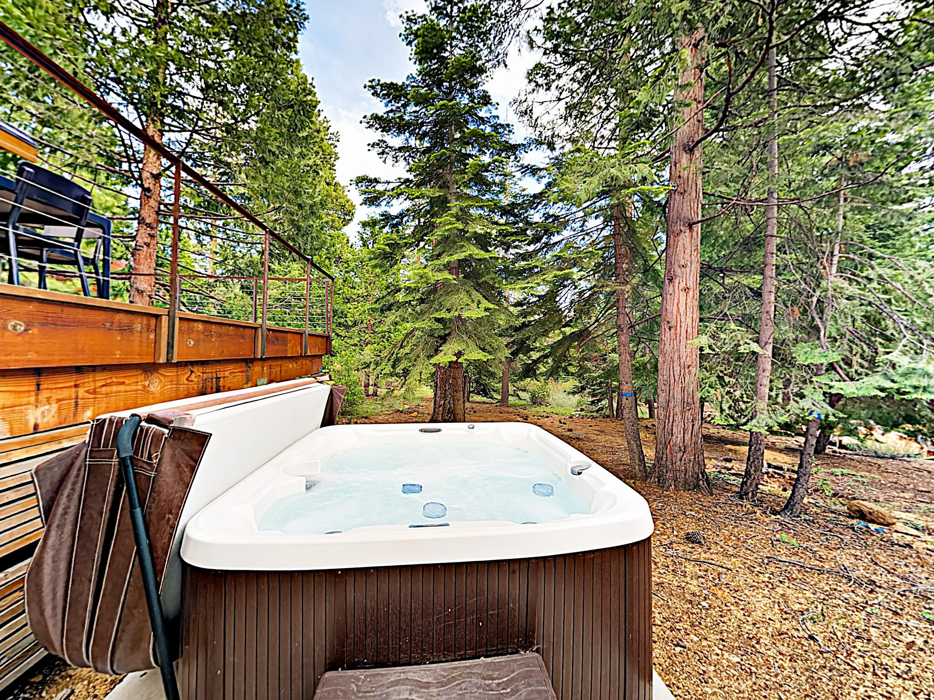 Enjoy wooded views from the privacy of the hot tub.