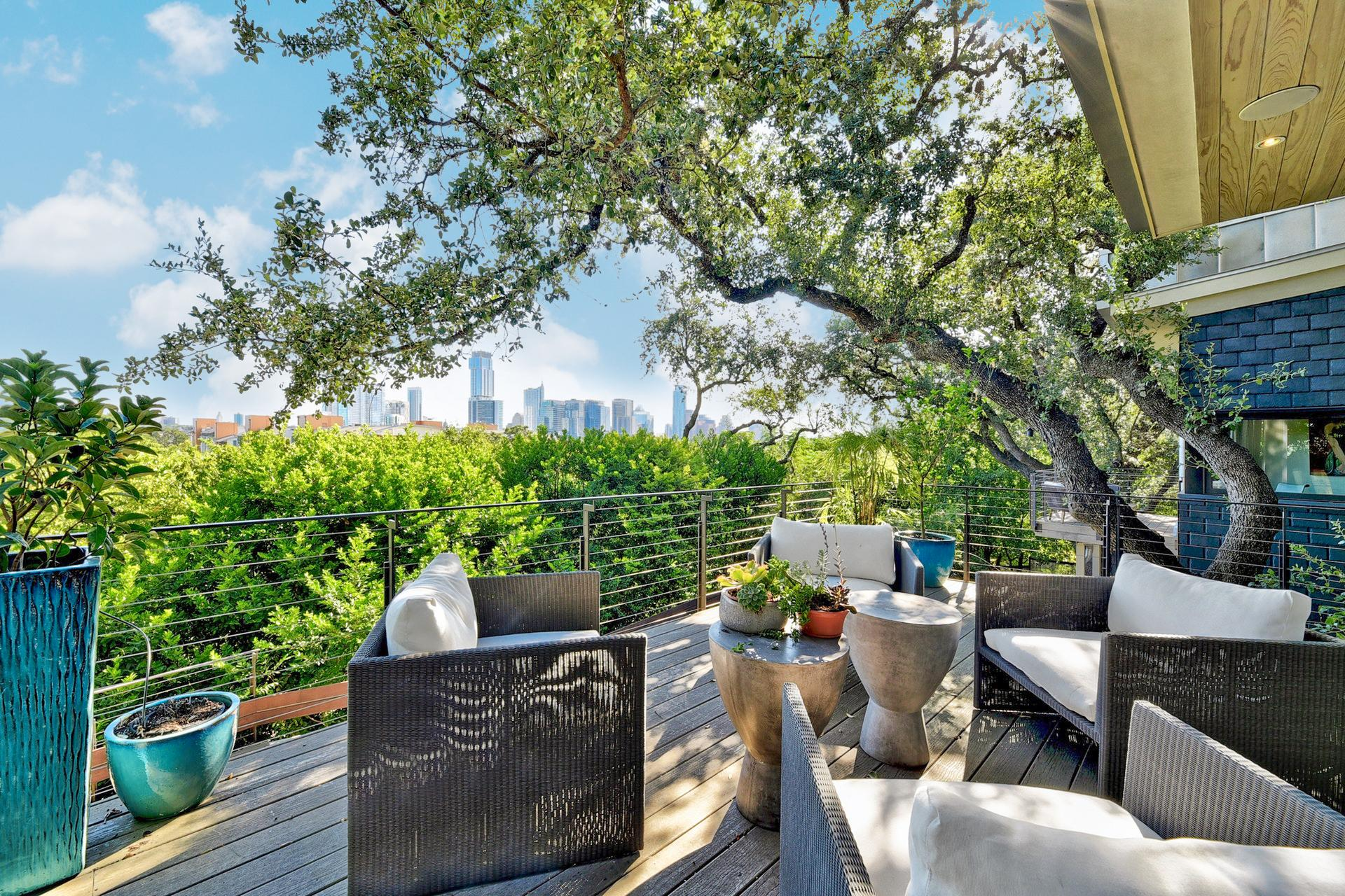 Enjoy jaw-dropping skyline views above the large heritage oak trees and enviable proximity to Barton Springs, Ladybird Lake, and Downtown Austin.