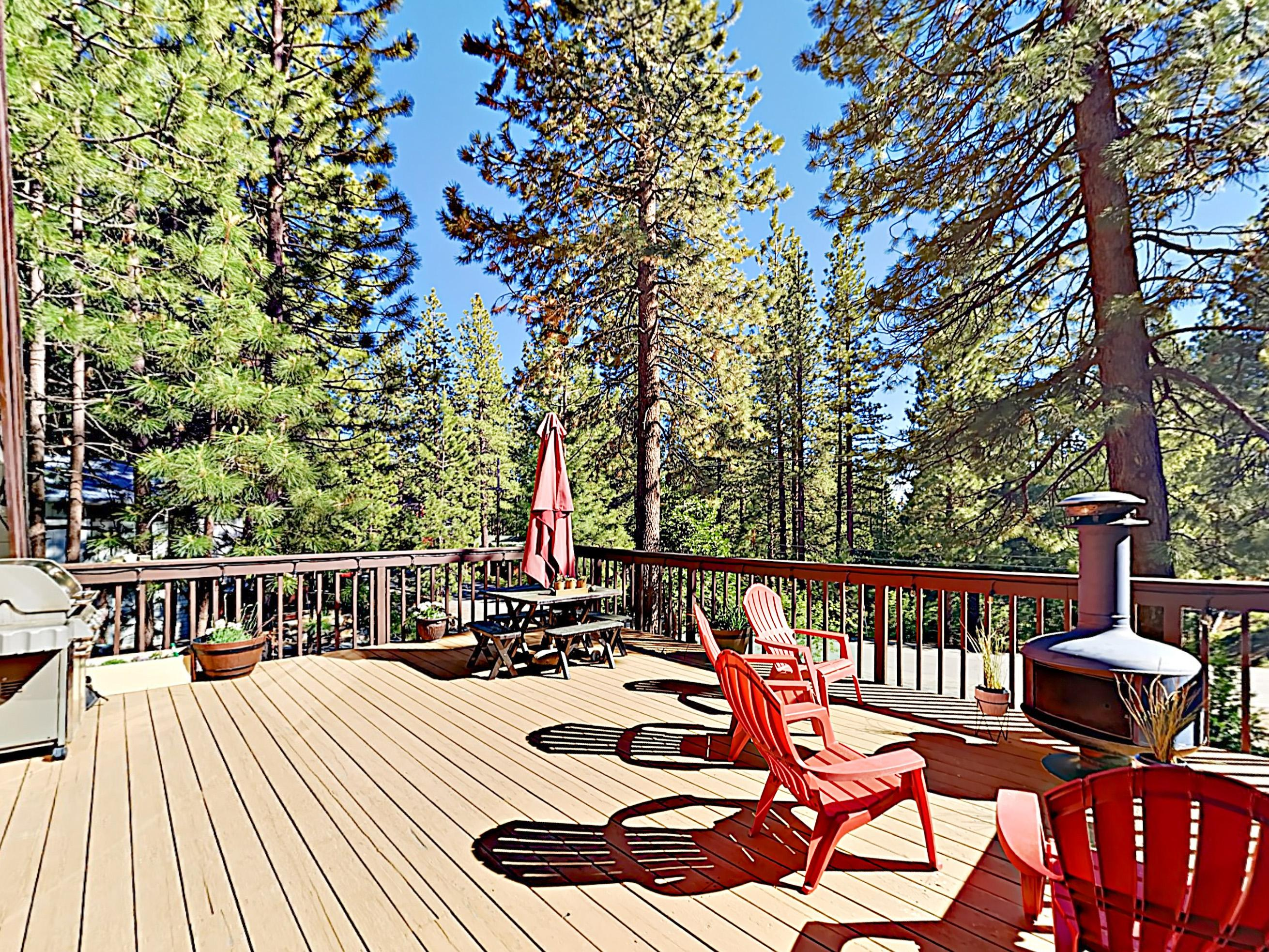 Unwind on your south-facing deck, featuring a picnic table, gas grill, outdoor seating, and chimenea.