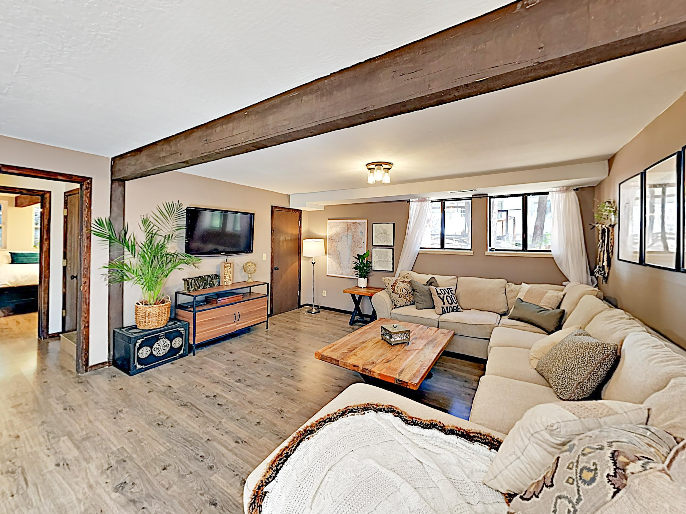 "On the lower level, a 2nd living area features a 47"" TV and queen-size sleeper sectional."