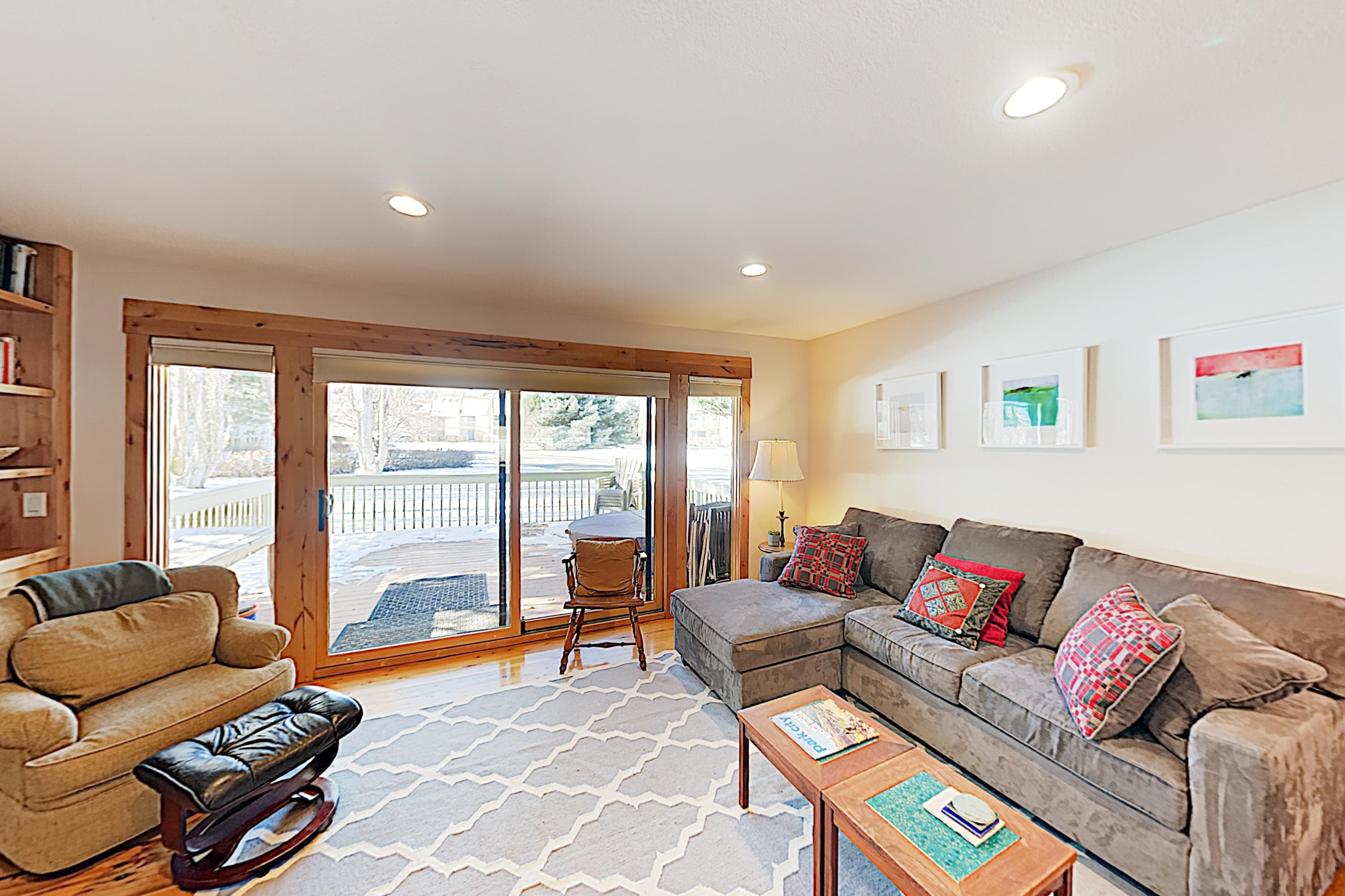Perfect for entertaining, the living area features glass doors that open to the back deck.