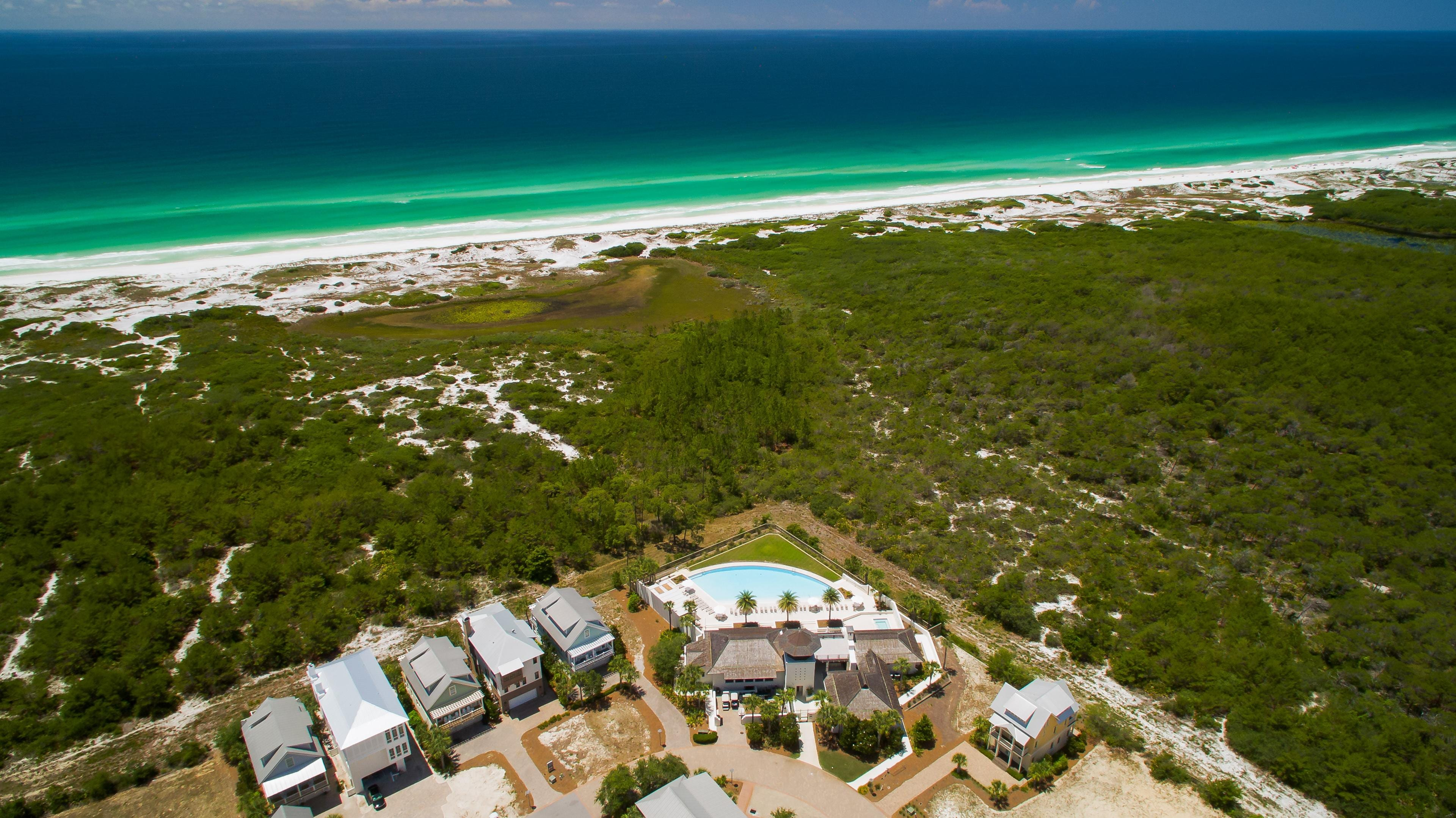 This coastal home is just a 5-minute drive from a sugar-white stretch of sand.