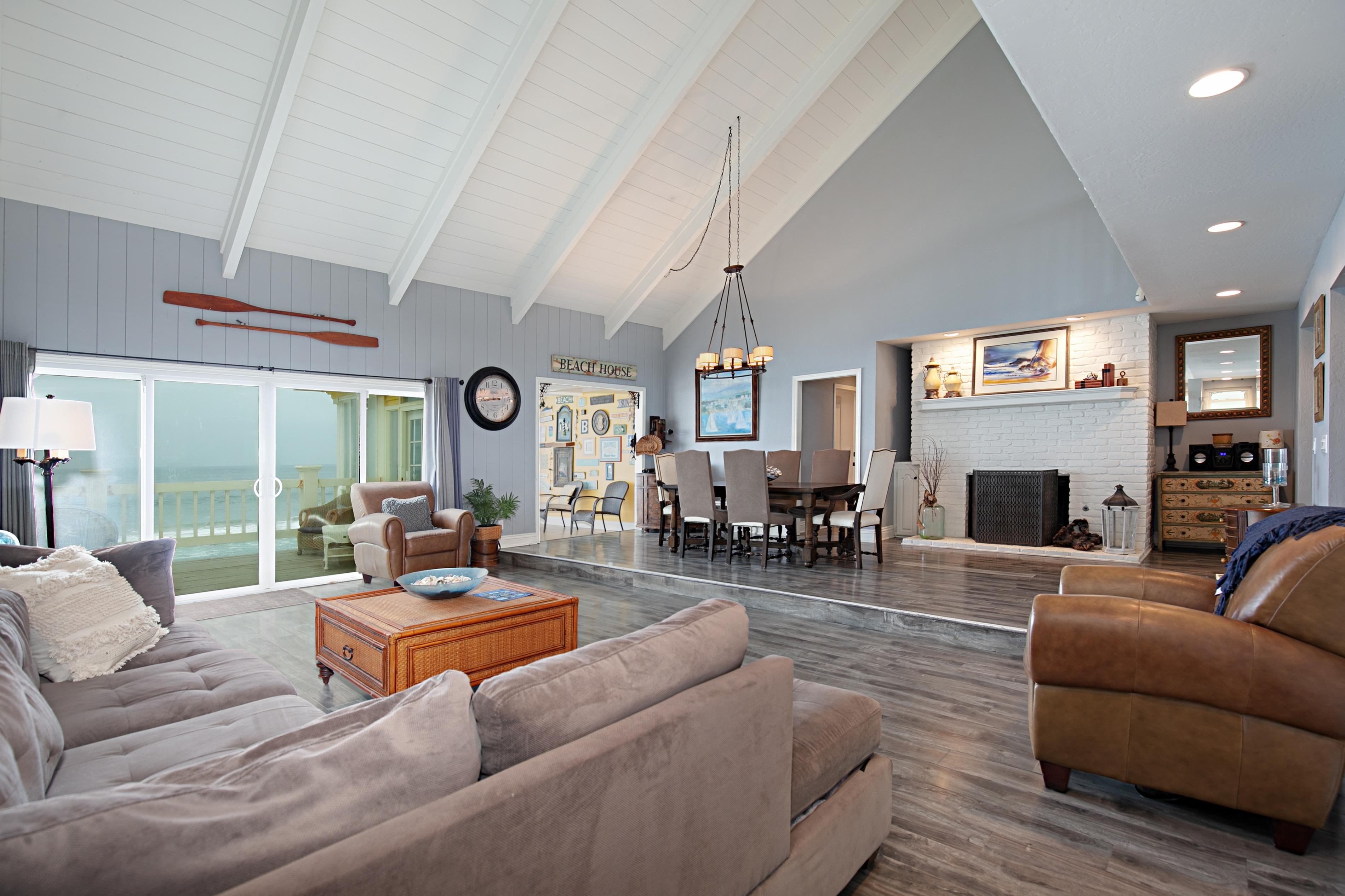 Vaulted ceilings soar in the open-concept living room.