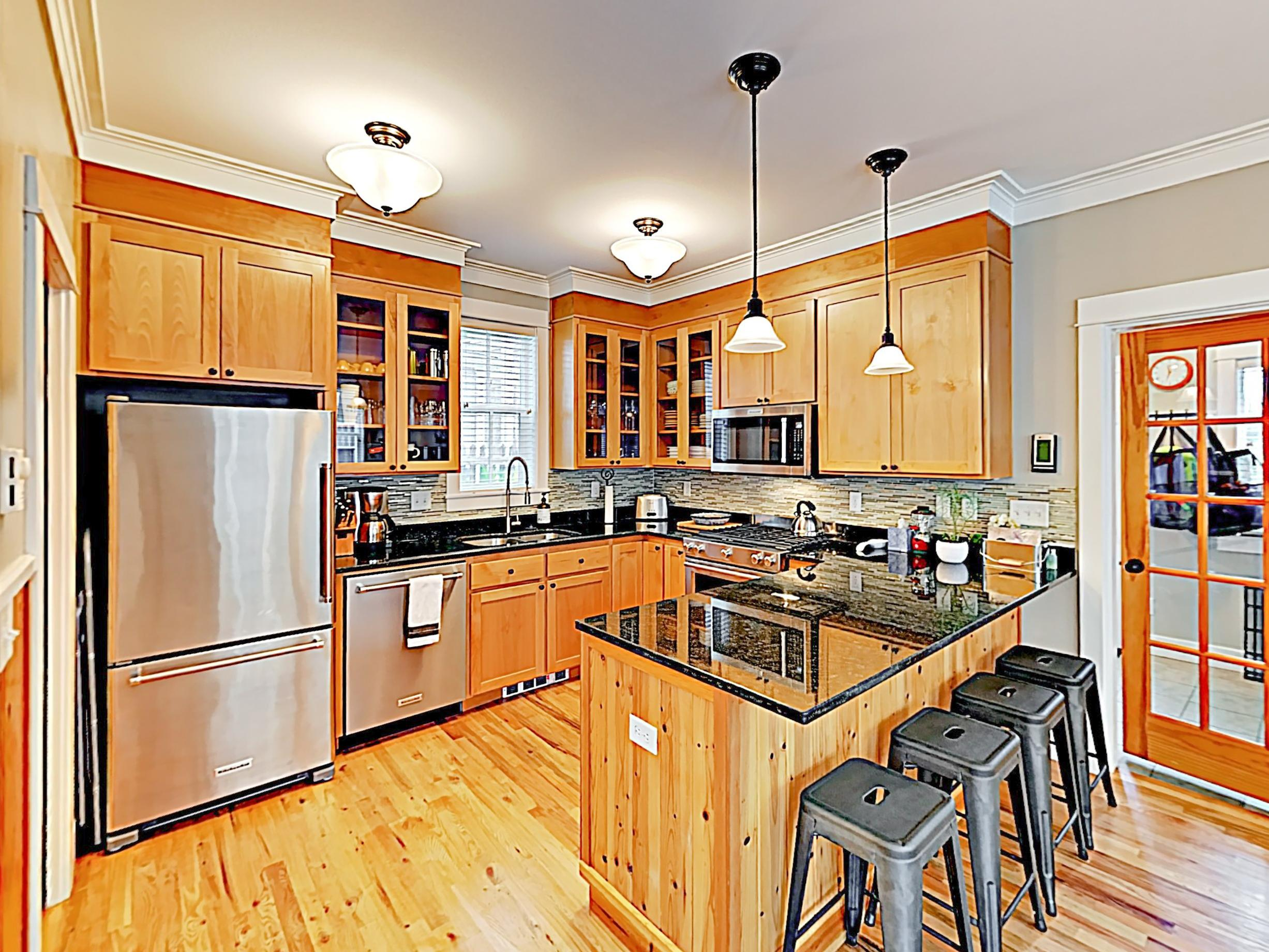 Chefs will appreciate granite countertops and stainless steel appliances in the kitchen.