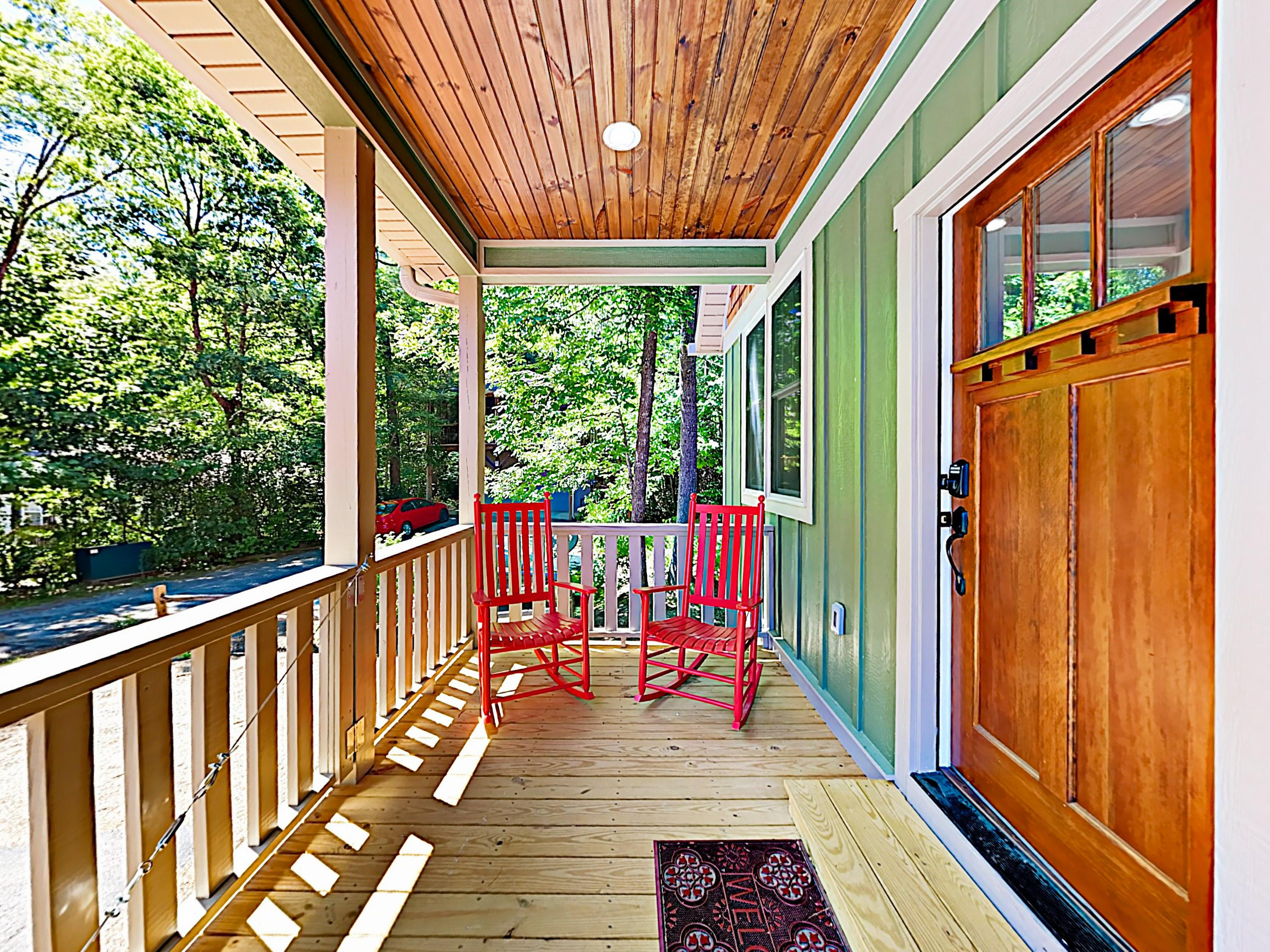 Spend balmy evenings on the front porch, furnished with 2 rocking chairs.