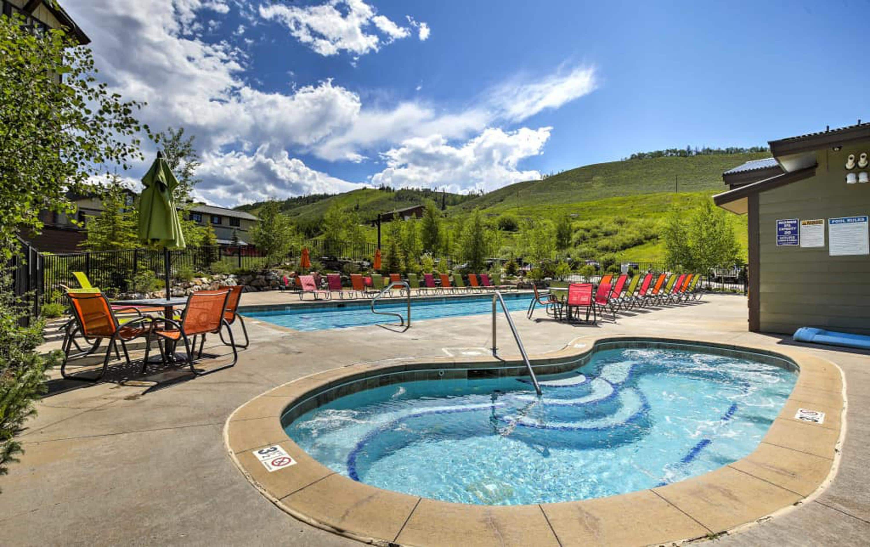 The Granby Ranch amenities include a large pool and hot tub.