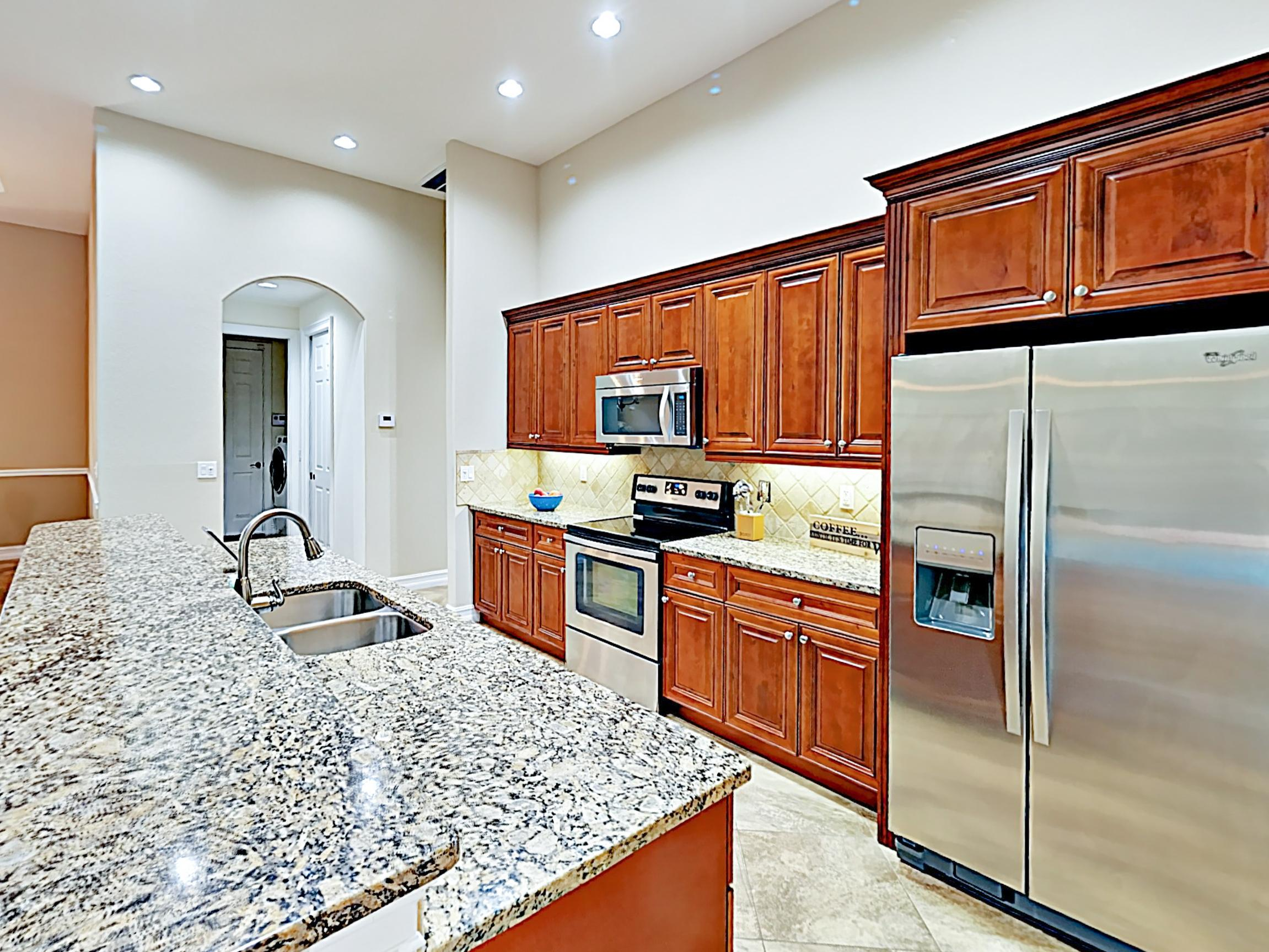 The chef in your group will appreciate the modern kitchen, equipped with a full suite of stainless steel appliances.