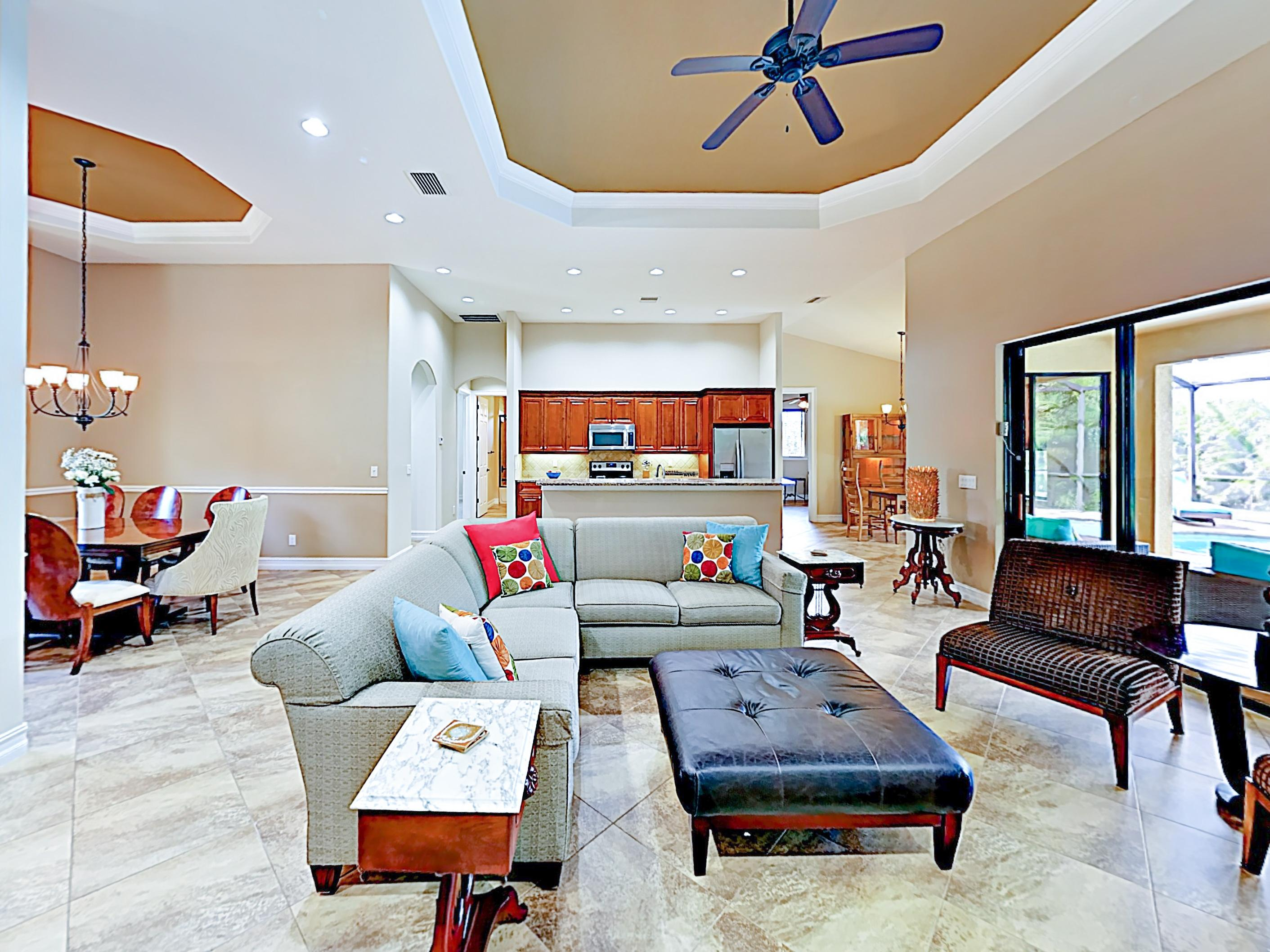 After a day in the sun, relax in the open living area, furnished with a plush sectional, ottoman, and 2 chairs.