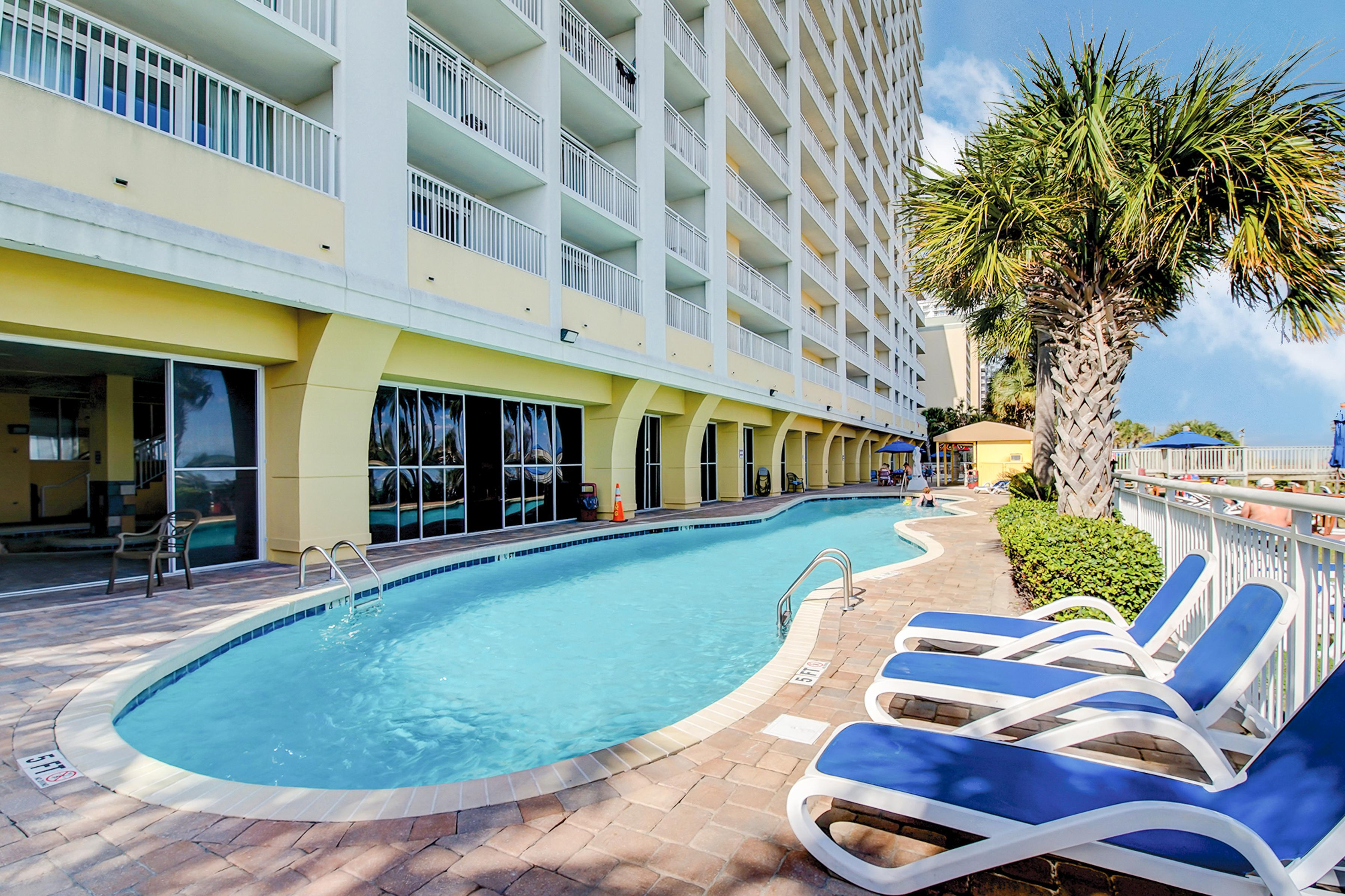 Your condo comes with resort-style amenities, including an oceanfront outdoor pool.