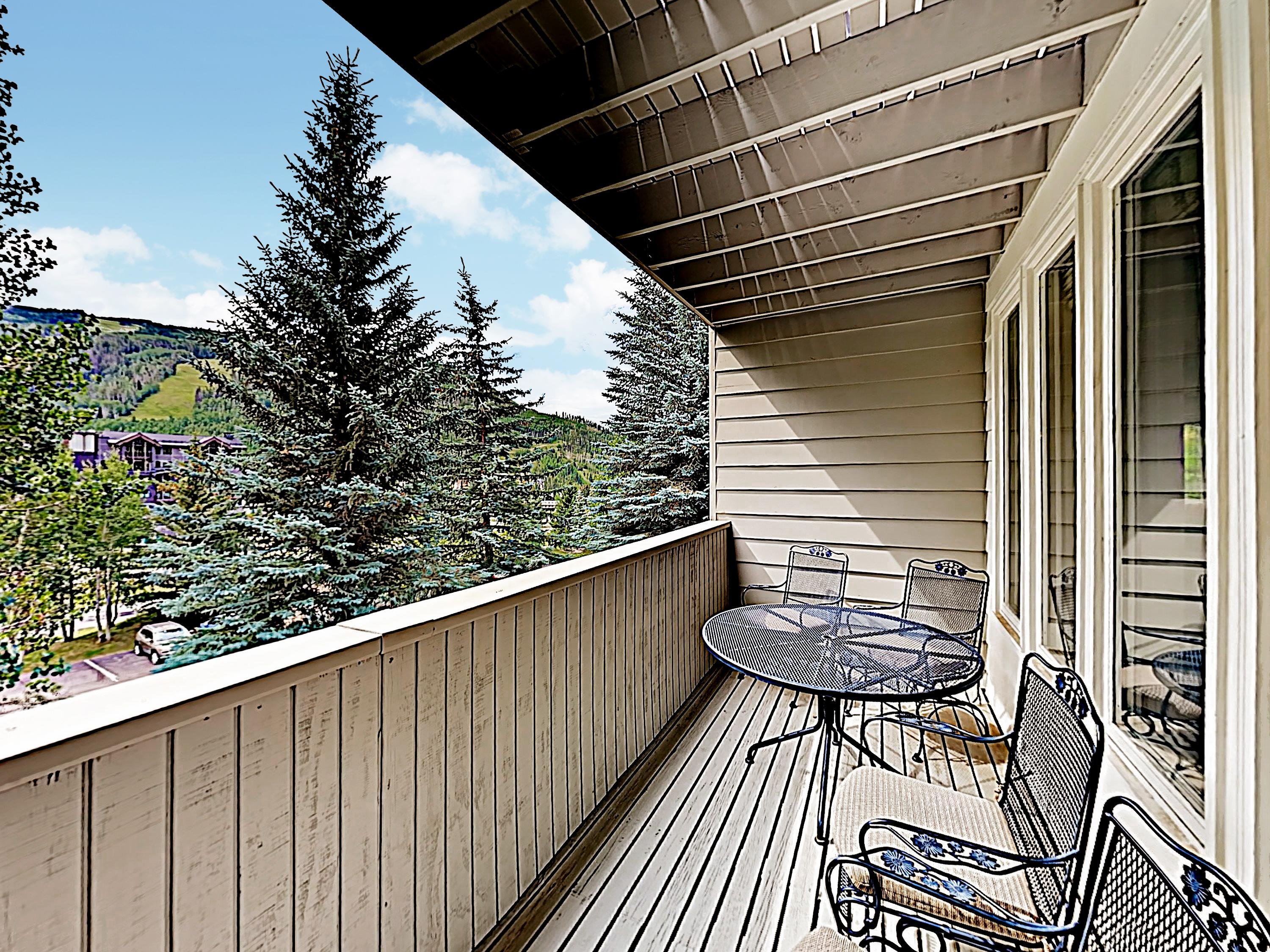 Enjoy a view of the mountains from a private balcony, offering a 4-person patio table.