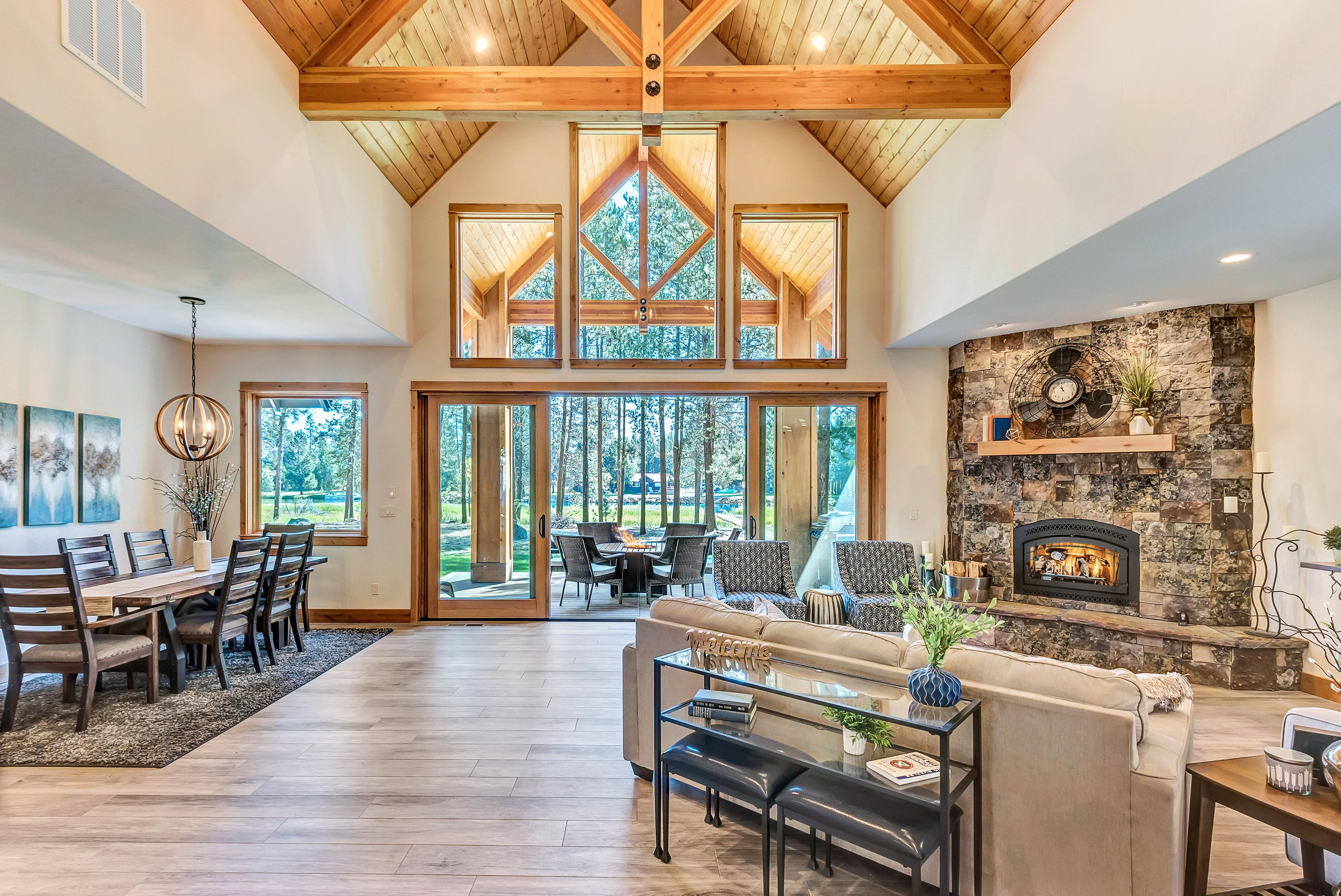 Vaulted ceilings with exposed wood beams are a highlight of the main living area.