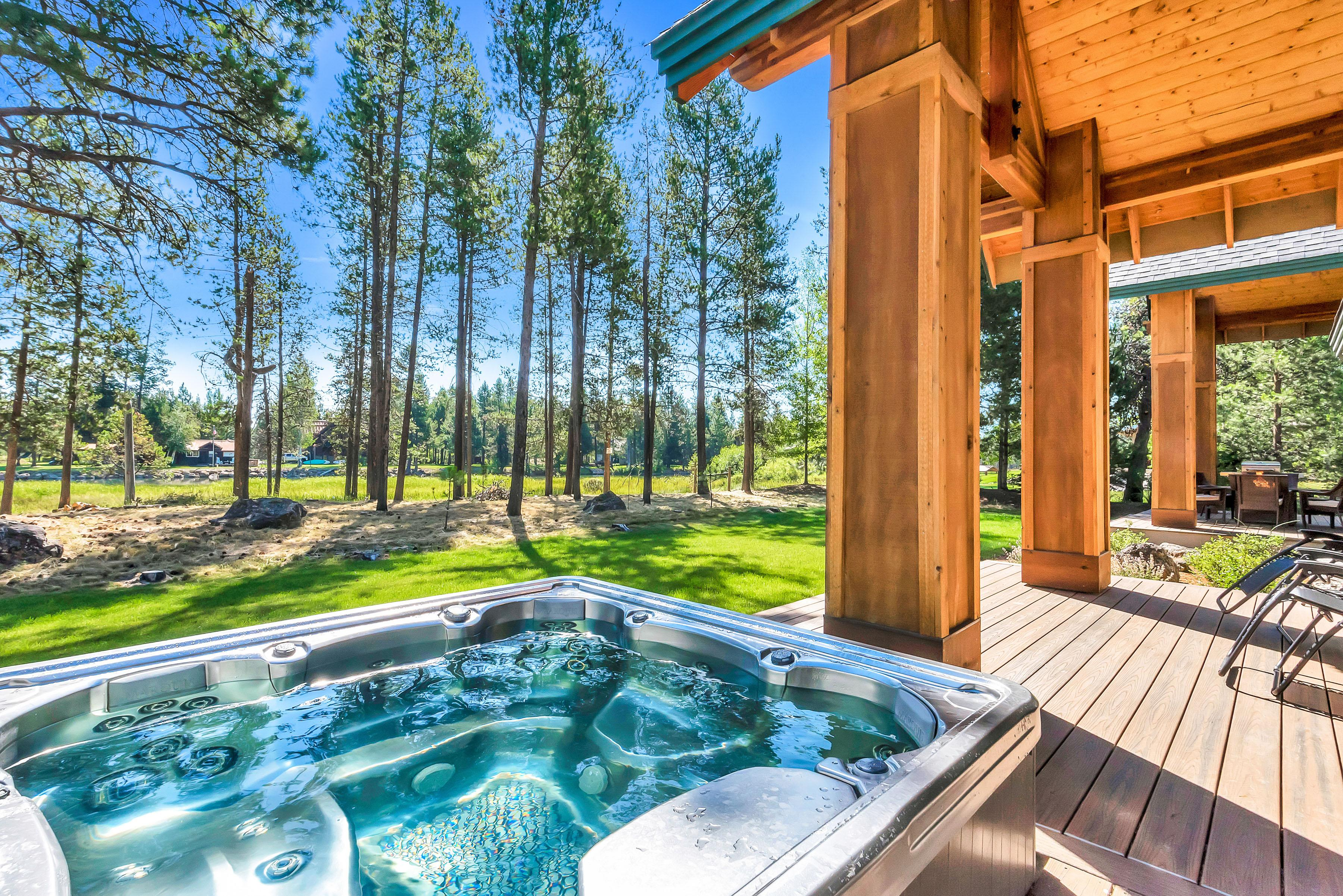 Soak in your private hot tub while enjoying views of the river.