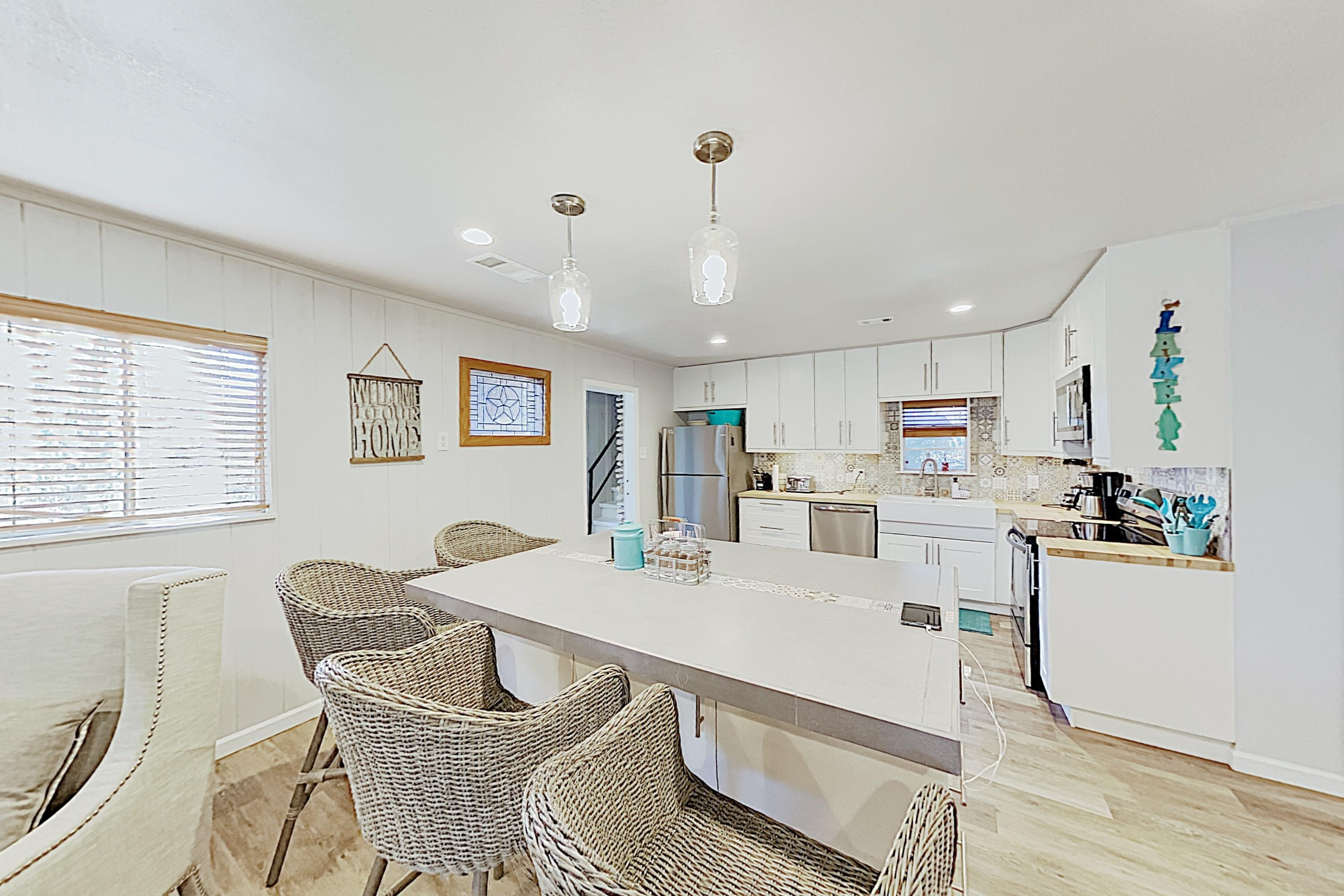 A large island in the kitchen offers seating for 4.