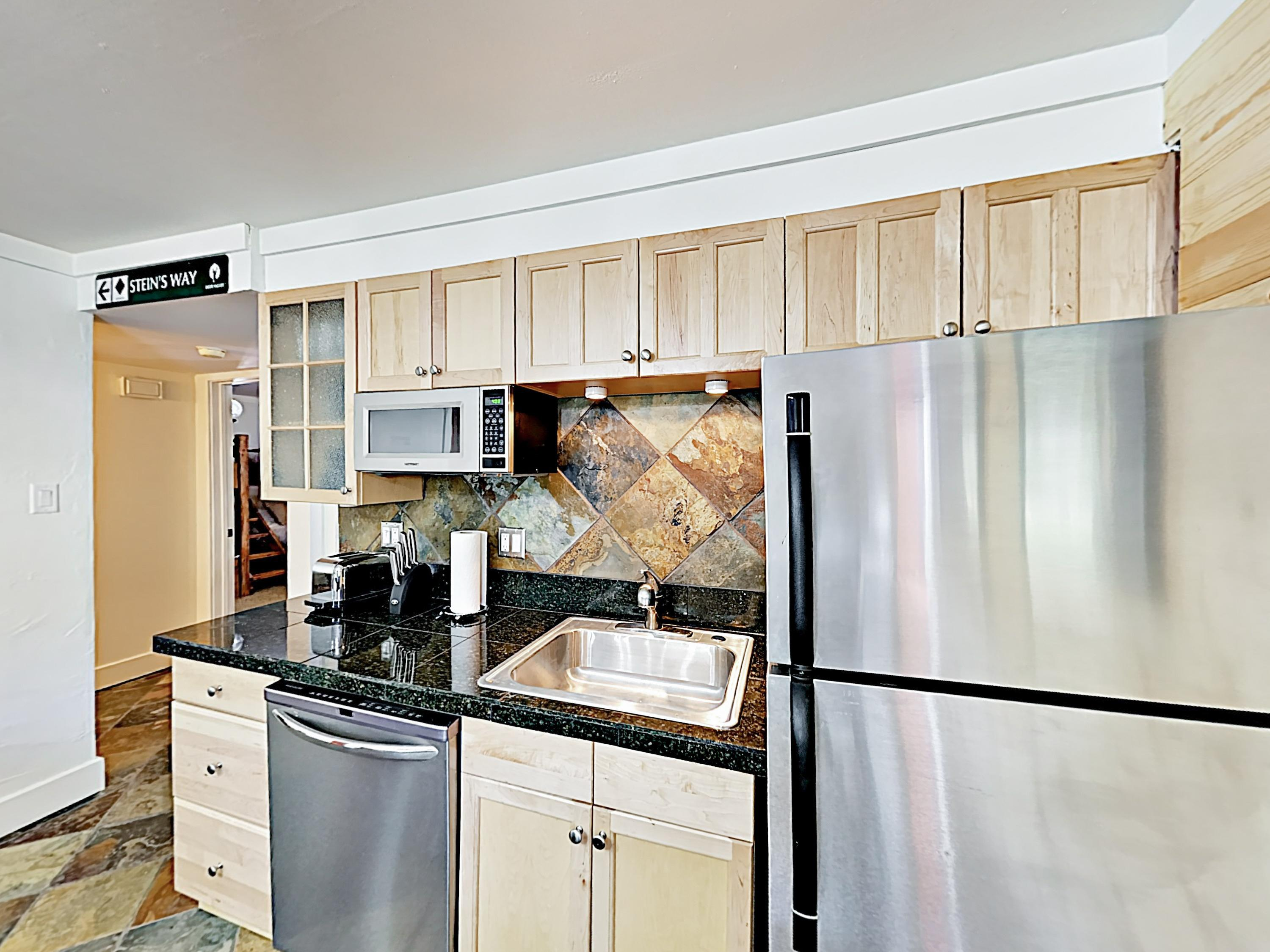 Channel your inner chef in the gourmet kitchen, outfitted with granite countertops, designer stainless steel appliances, and stone tile.
