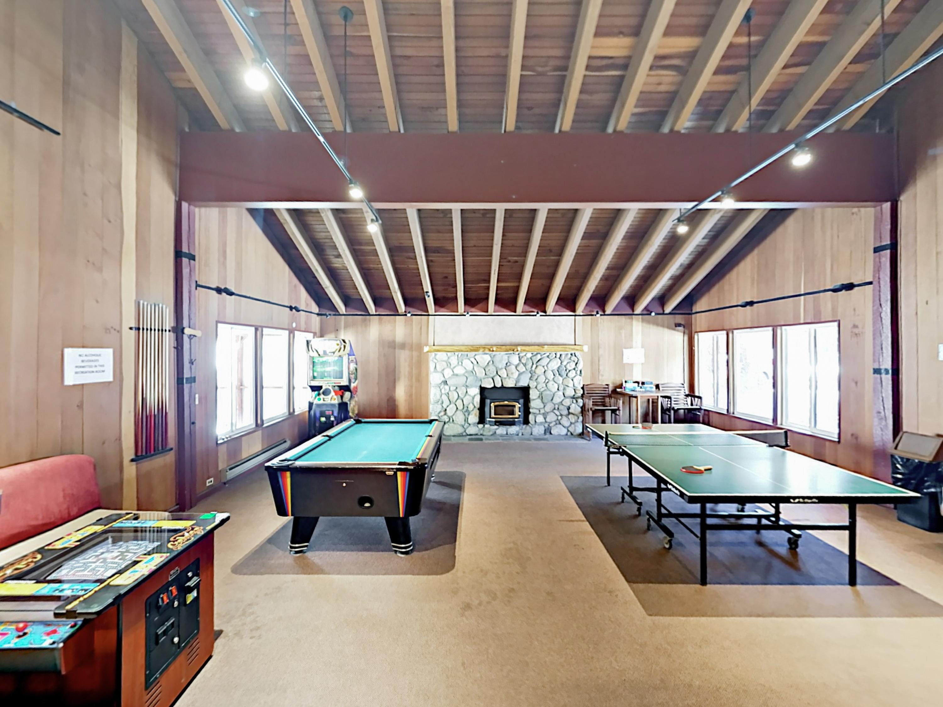 Head to the shared recreation room for billiards, ping-pong, and arcade games.