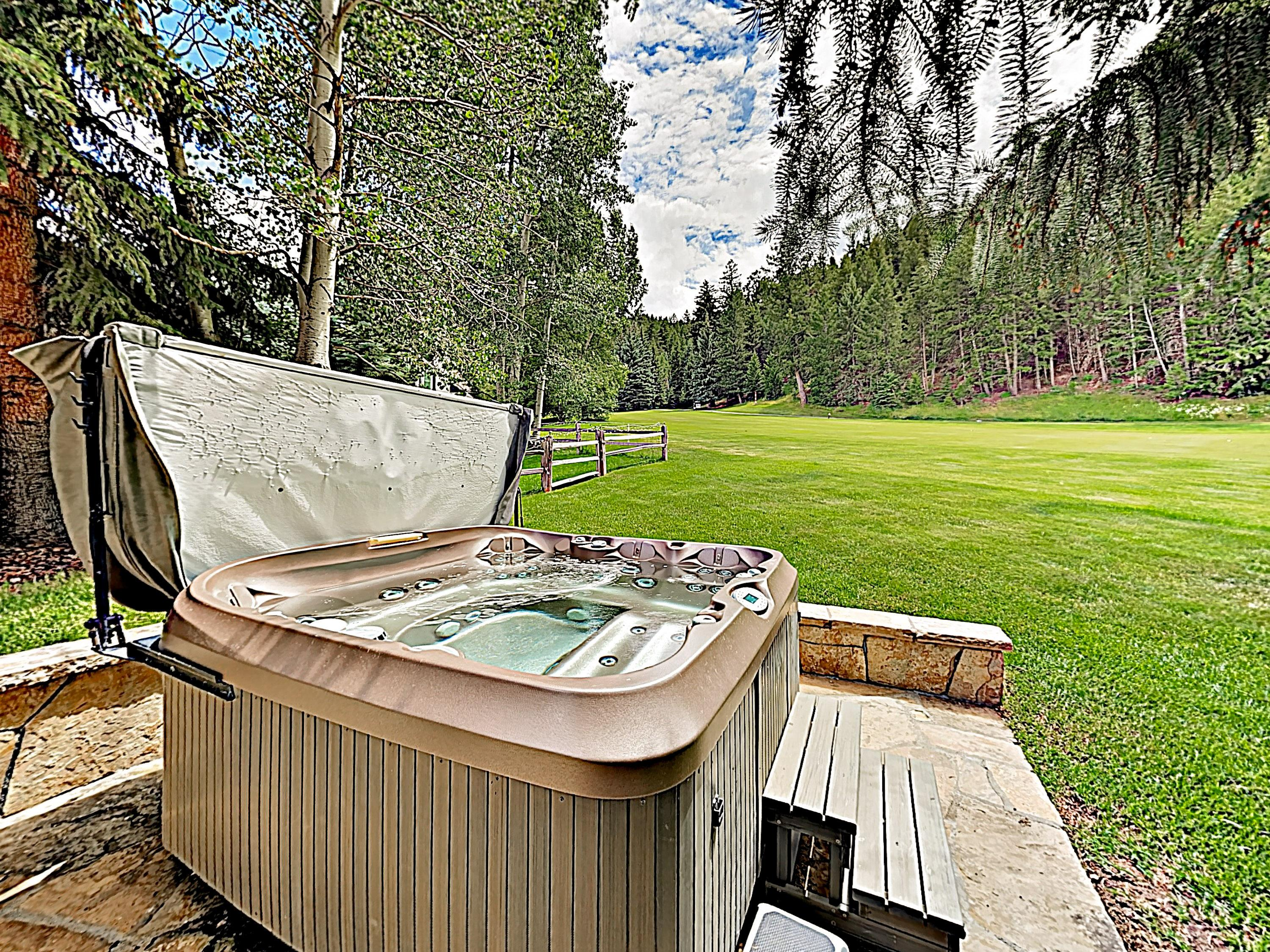 Soak in your private hot tub after a day of alpine adventures.