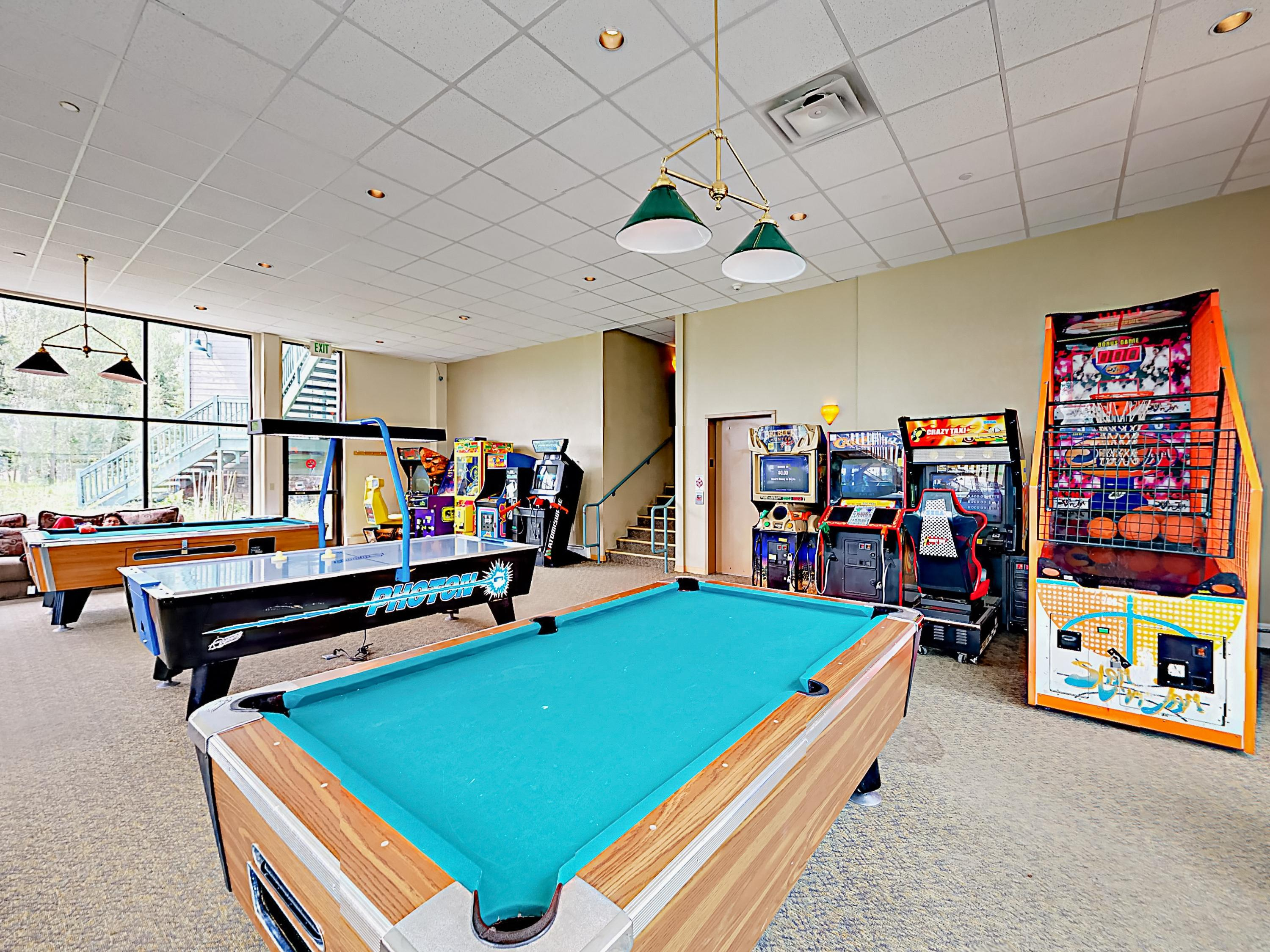Mingle in the lounge, play a game of billiards, or hone your skills in the arcade.