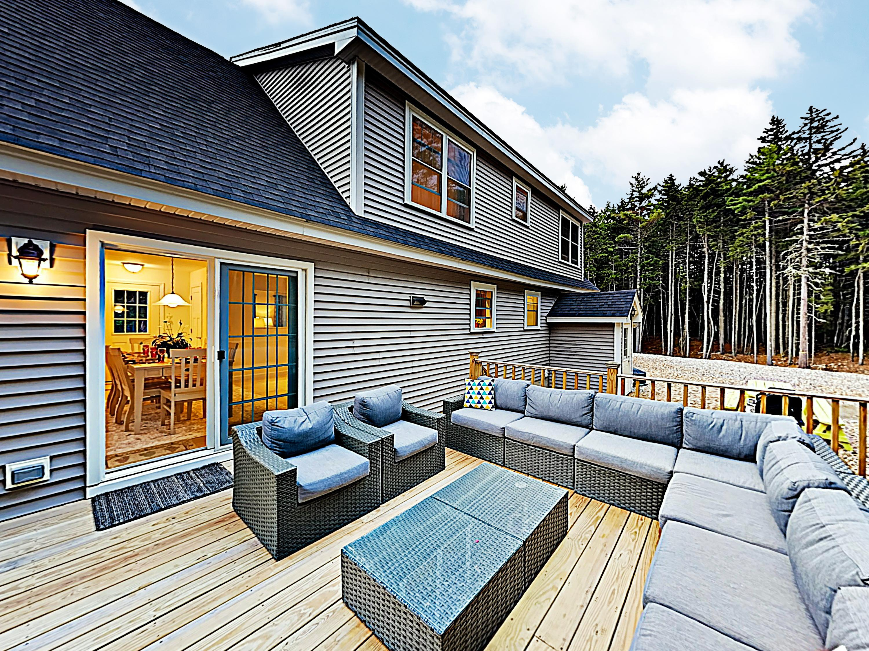 Lounge on the huge sectional and outdoor armchairs on your private deck.